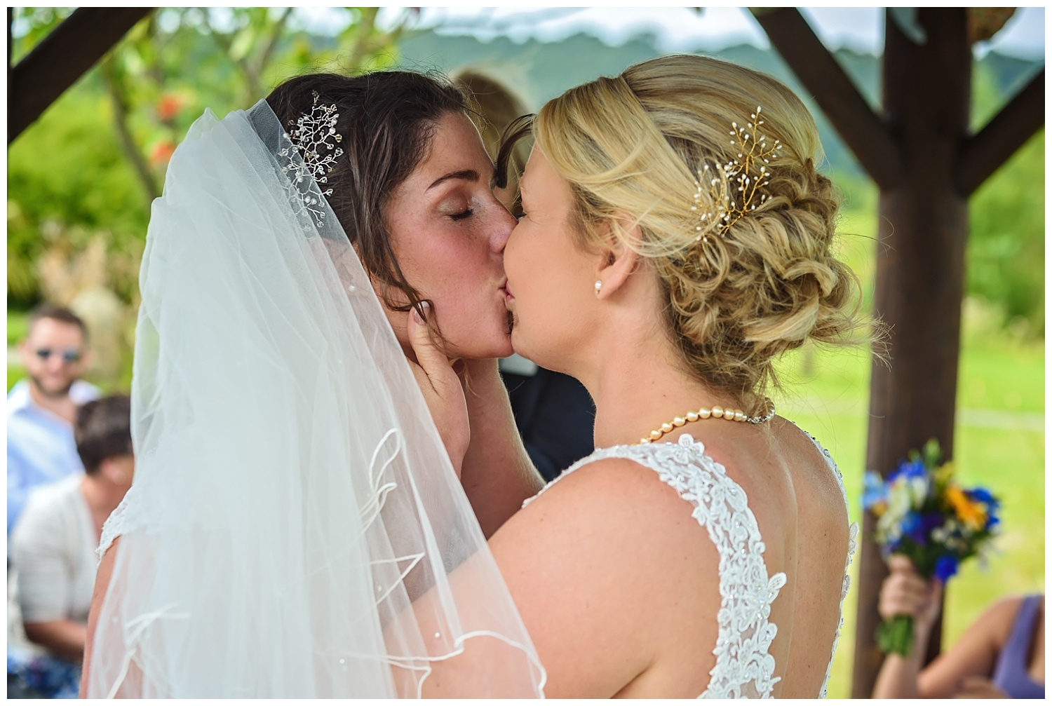 lesbian wedding first kiss | Ox Pasture Hall | Surrey wedding photographer