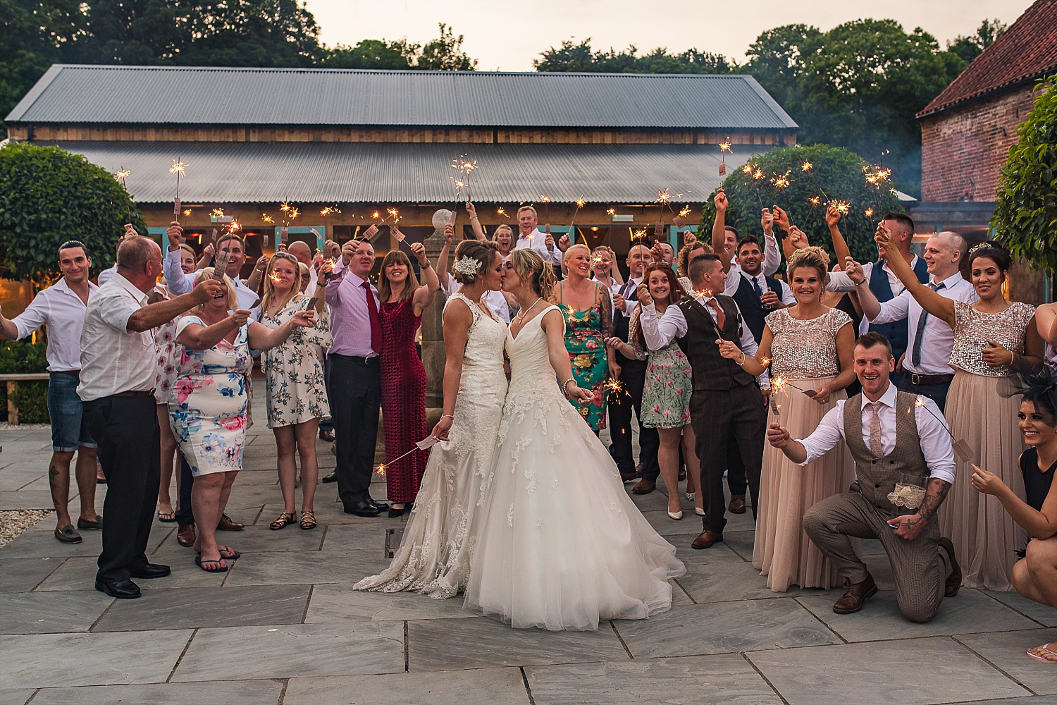 Brides celebrate with sparkler exit Hazel Gap Barn