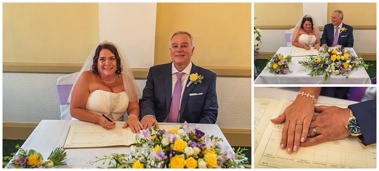 bride and grrom signing the register