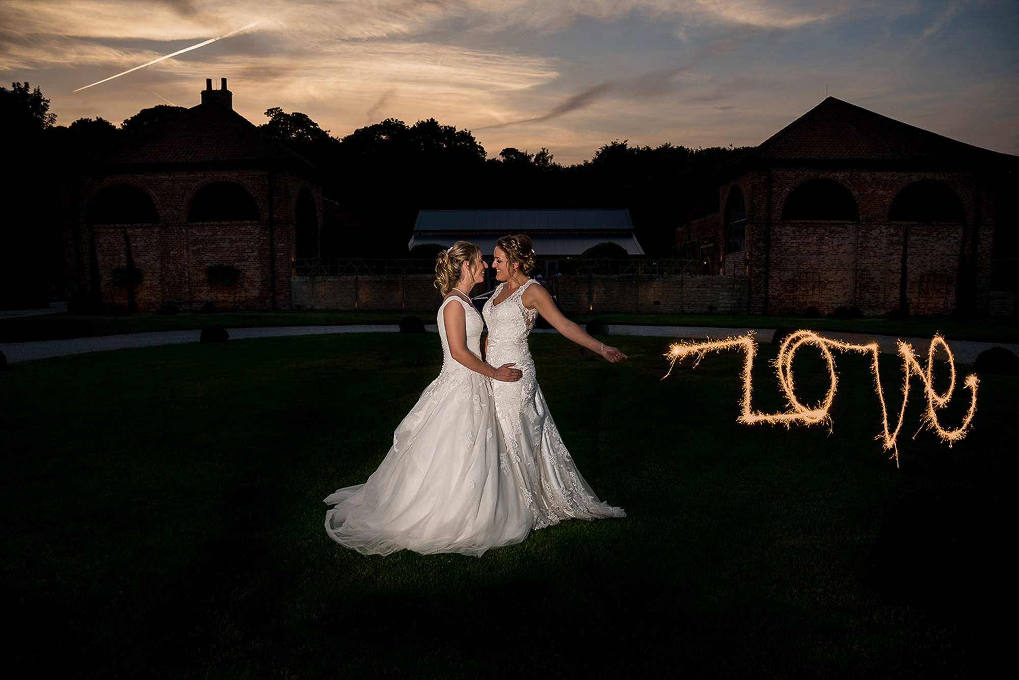 """Charlotte and Gemma, Hazel Gap Barn, Nottinghamshire - """"Alex photographed our wedding day in June 2017 on the hottest day of the year! He was very professional and captured so many special moments perfectly without being imposing or bossy. We think of Alex as being one of our guests at our wedding as he got on really well with all our friends and family, which meant that he was able to take very natural photographs. We couldn't have asked for better memories of our wedding day and we cannot recommend him highly enough. Thanks again Alex!"""""""