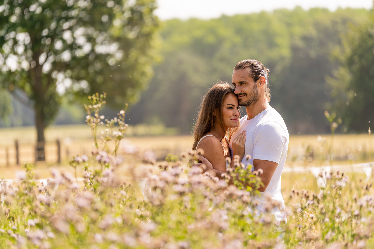 A happy couple during their engagement shoot in Surrey captured by Alex Buckland Photography