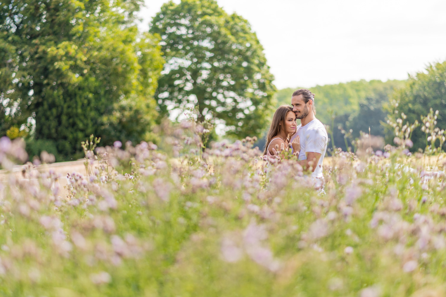 Stunning couple share intimate moment during Surrey pre wedding shoot