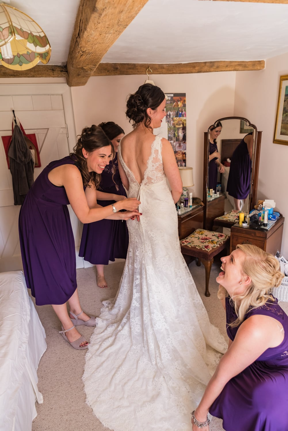 016-bridesmaids-helping-bride.jpg