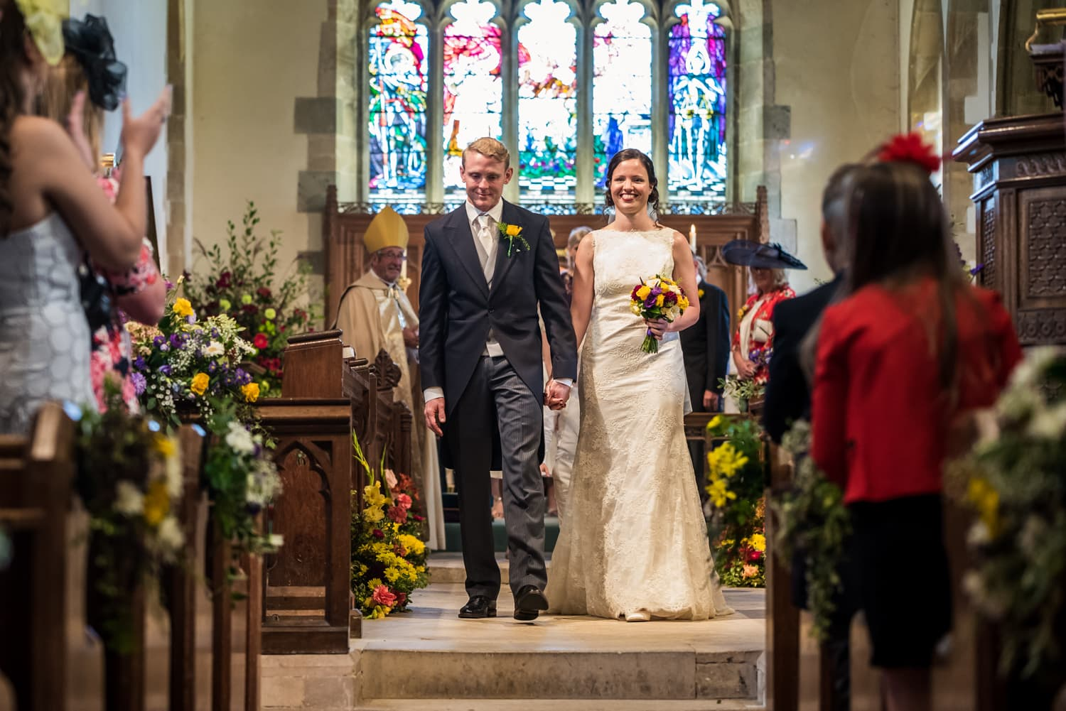 056-bride-and-groom-walk-aisle.jpg