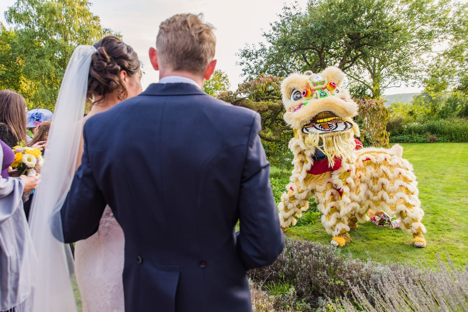 077-bride-groom-watching-lion-dance_1.jpg