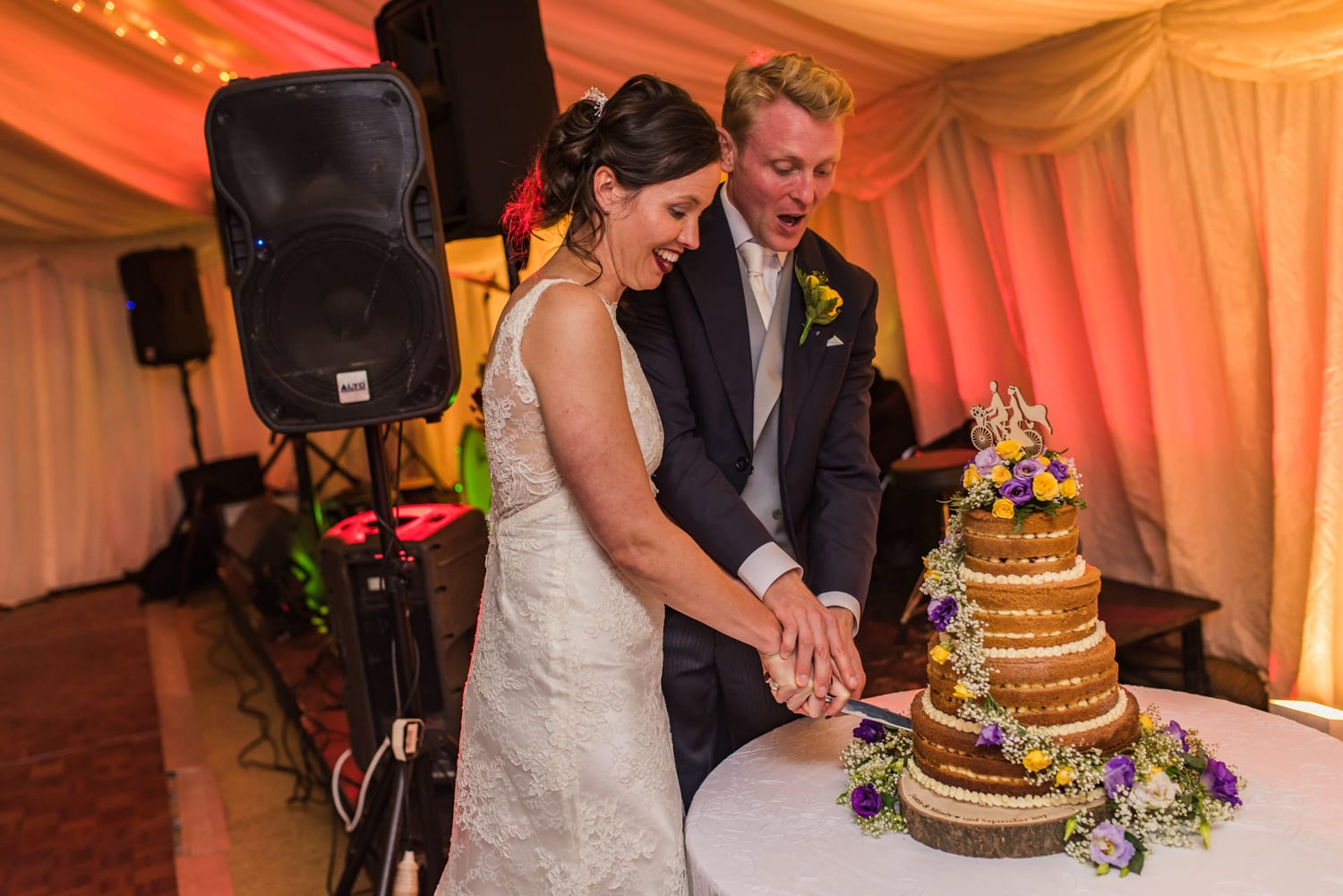 110-bride-and-groom-cut-cake.jpg