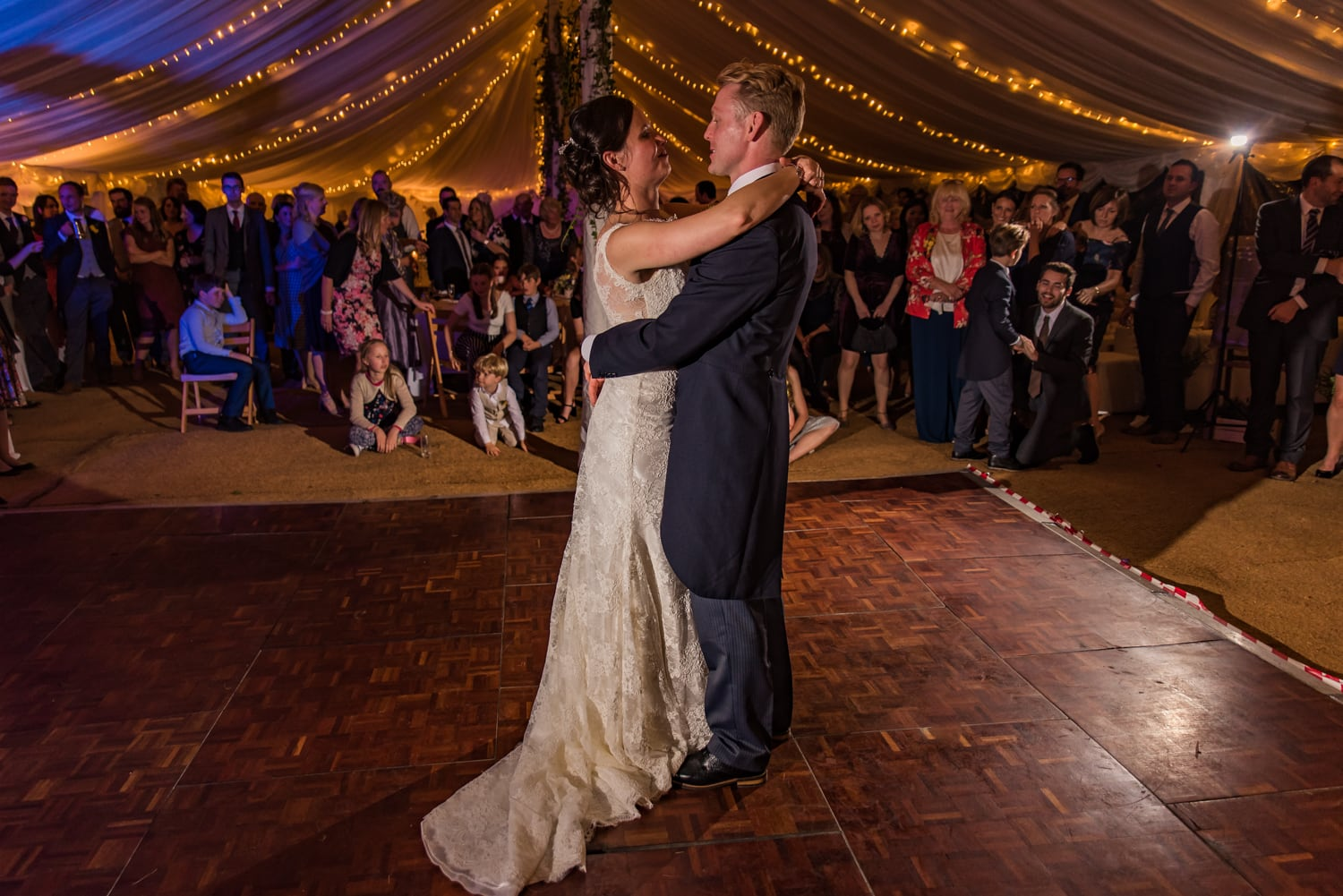 119-bride-groom-first-dance-guests.jpg