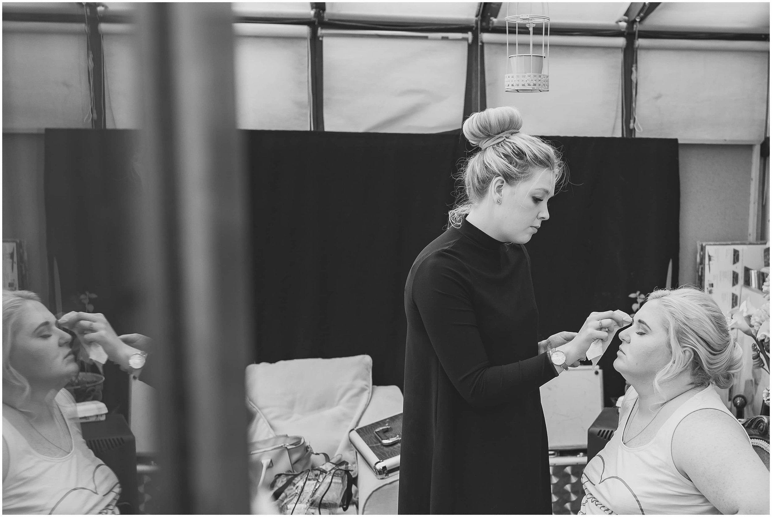 Bride getting makeup done captured by Surrey wedding photographer