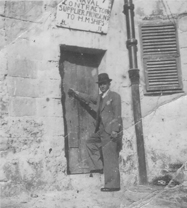 Eucharist Zammit on the doorstep of one of his warehouses.