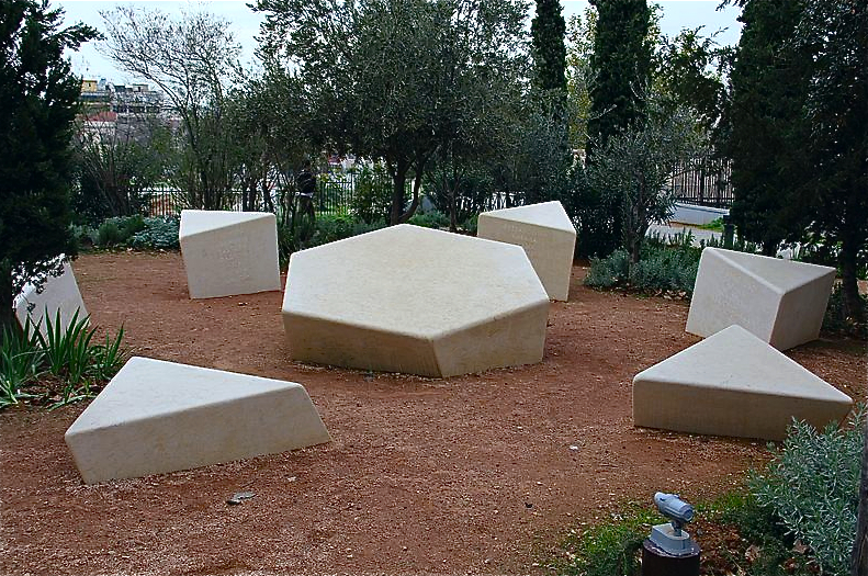 The central site in Athens is transformed into a compass to show the orientation of the places throughout Greece from which Jews were rounded up and sent to concentration camps.