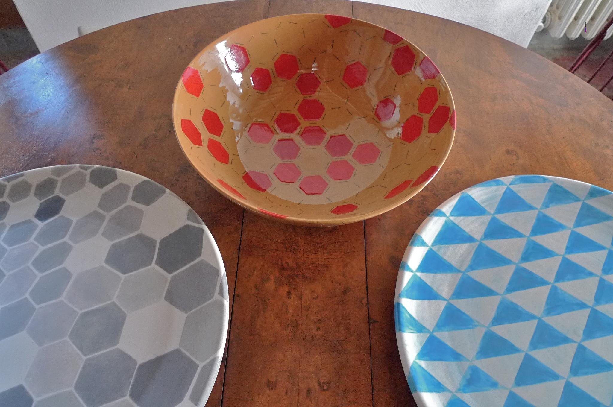 various: white ceramic plate heavy: blue triangle, grey hexagon perspective solid 40cm (250 E) terra cotta bowl red hexagon 40cm (350E)