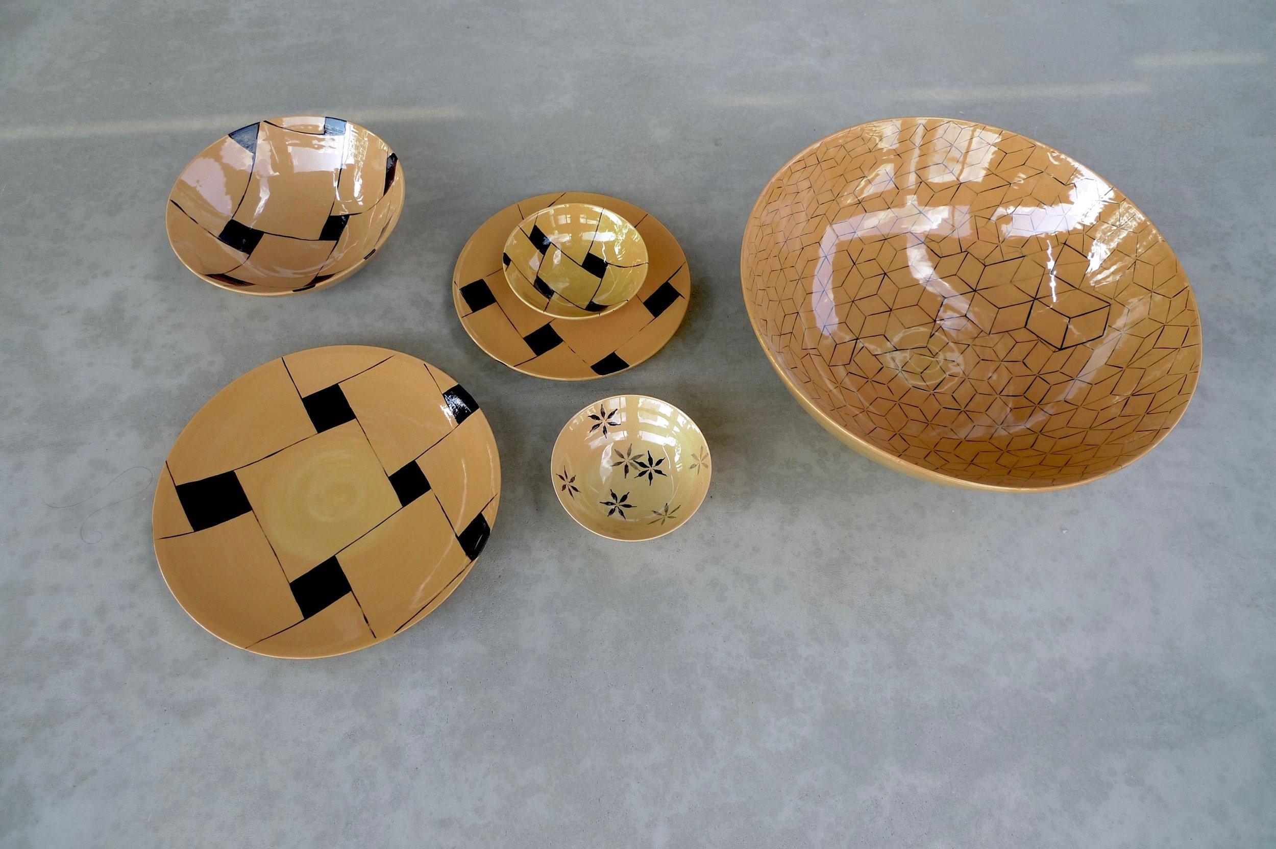design on terra cotta bowls: 16x36cm (350E),7x20cm (60E),3x13cm (45E) plates 28cm (80),22cm(40E)