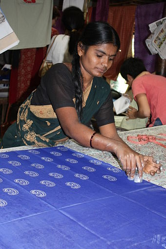 Woman doing Block Printing at Halasur village,  Karnataka , India.
