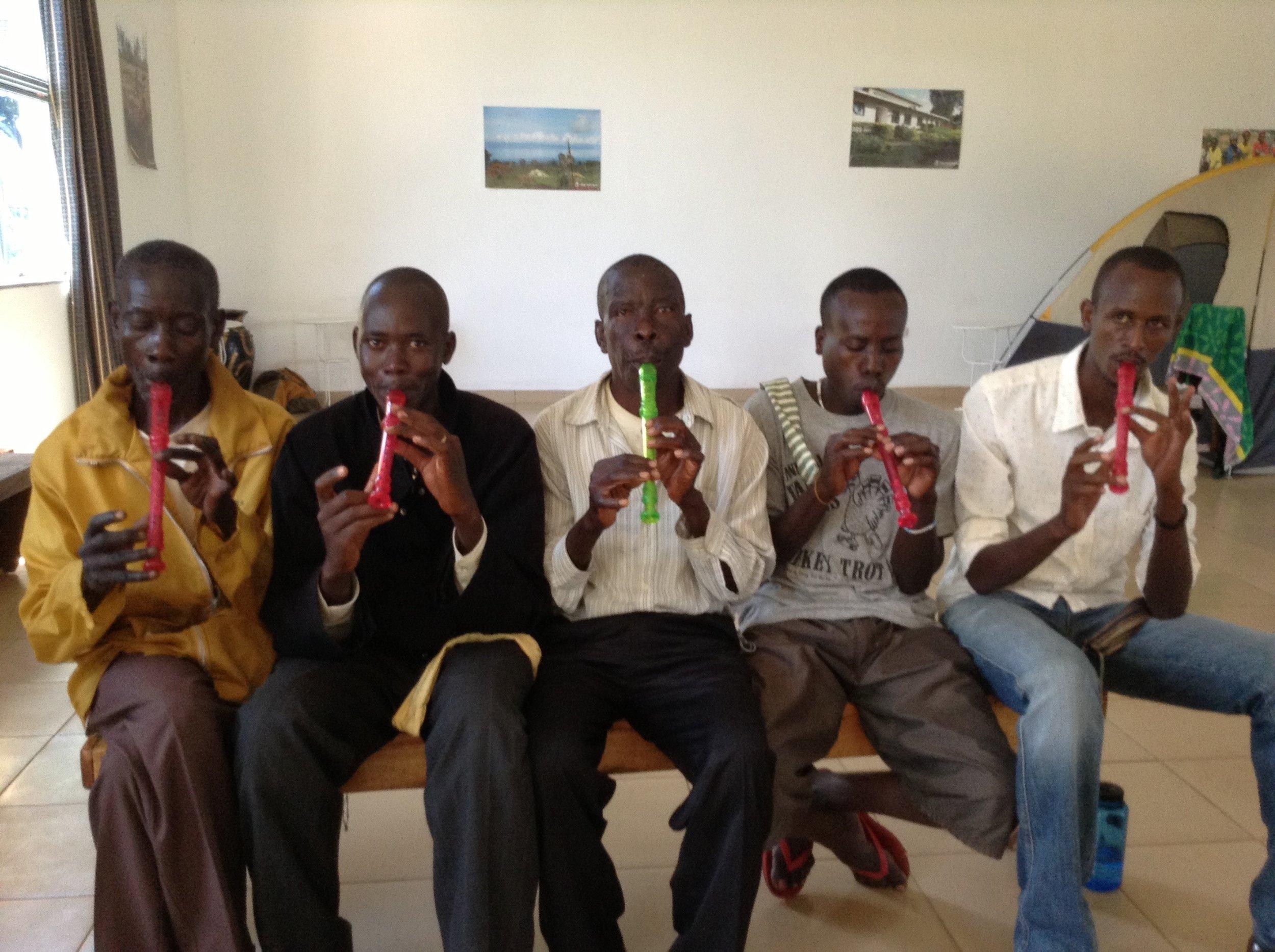 Burundi Traditional Musicians Learning Recorder.jpg
