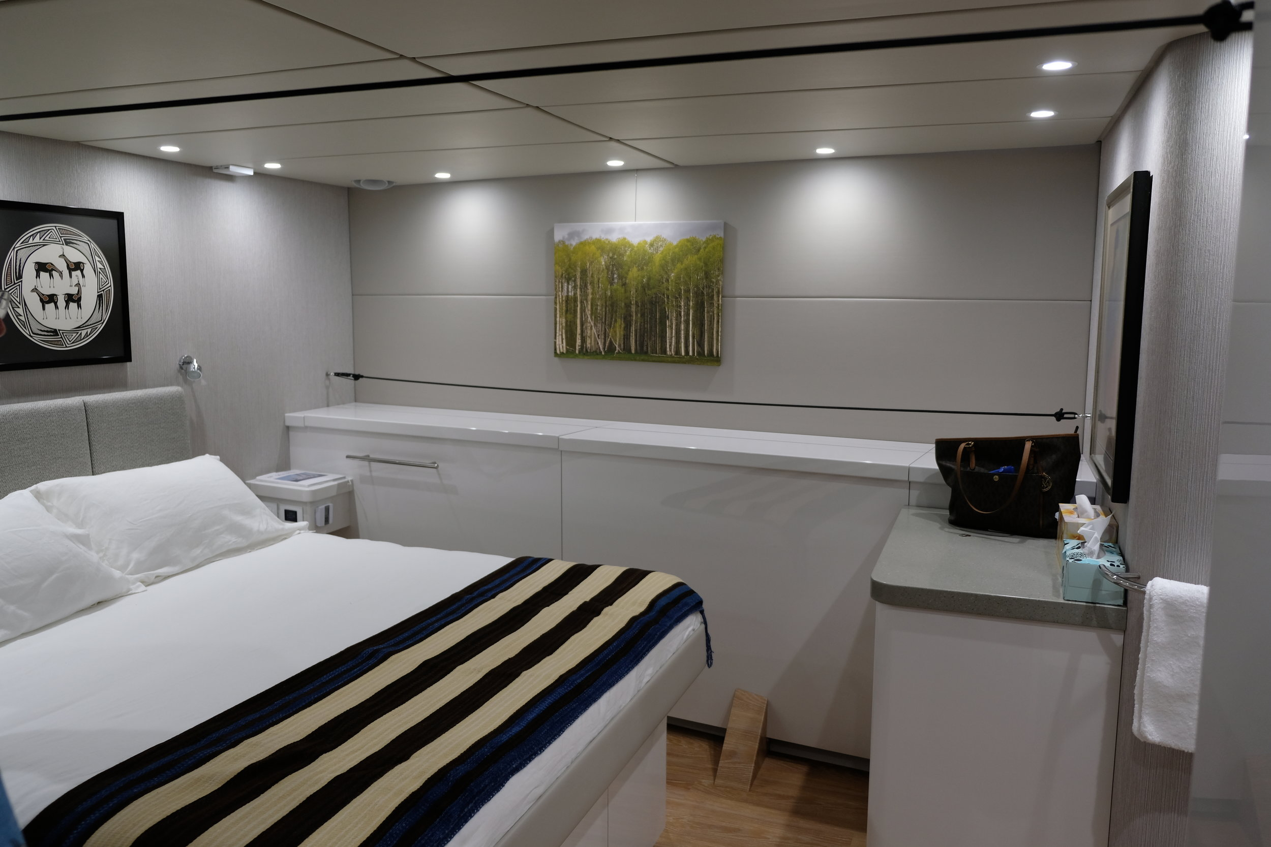 The master stateroom is roomy with enormous storage within easy reach. The ensuite head and shower are forward of this cabin, and are nothing like the cramped quarters one finds in so many boats.