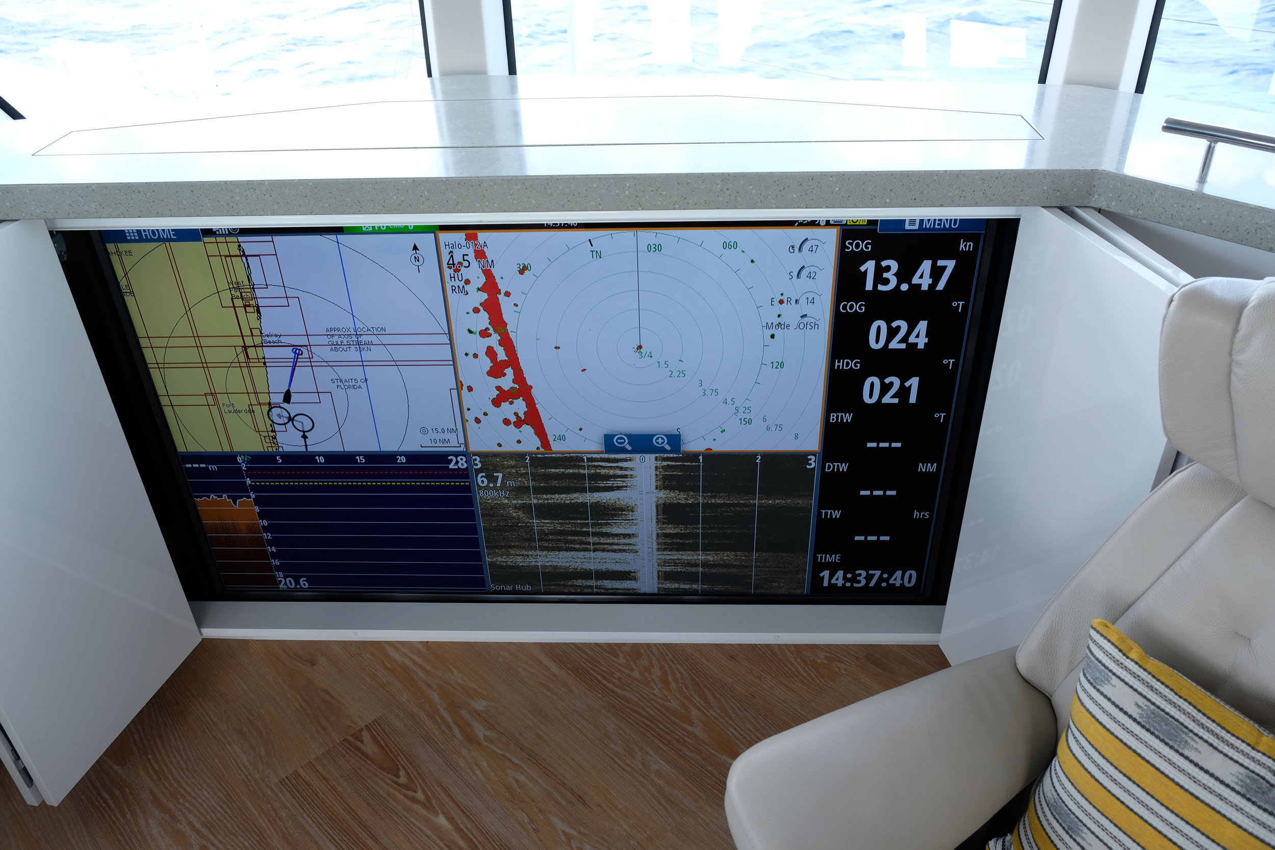 "Large screen display in the main saloon is controlled by a remote to display all variations of navigation and other information. Note our boat speed is 13.47 knots as conditions that have us alone in the ocean off Ft Lauderdale. ""You went out today!?!"""