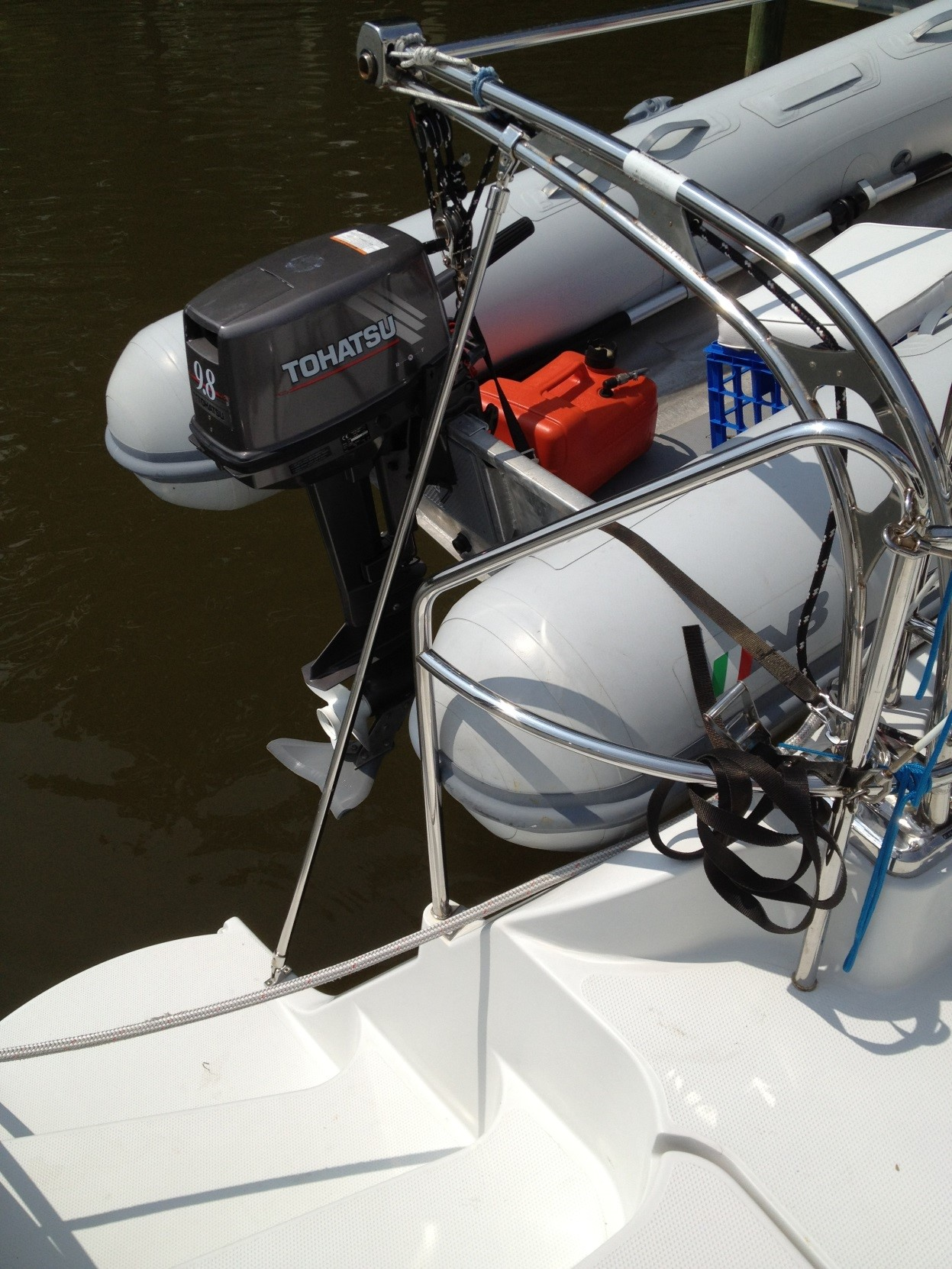 Added struts support a greater weight than the original Edson design. Note the blocks and lines for easier dinghy handling. Such davits are so easy to use and are one big advantage of a power catamaran.
