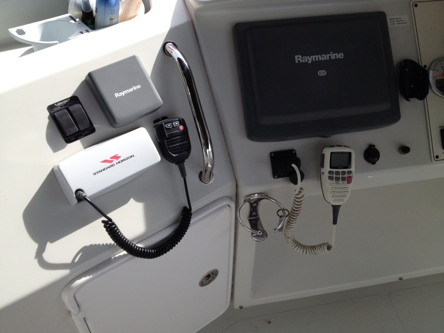 The two radios, dedicated depth sounder and Kahlenberg horn controls to the left of the helm chair. The flybridge helm is a great place to run the boat in all but extreme conditions. A new cover protects all of these electronics from the elements.