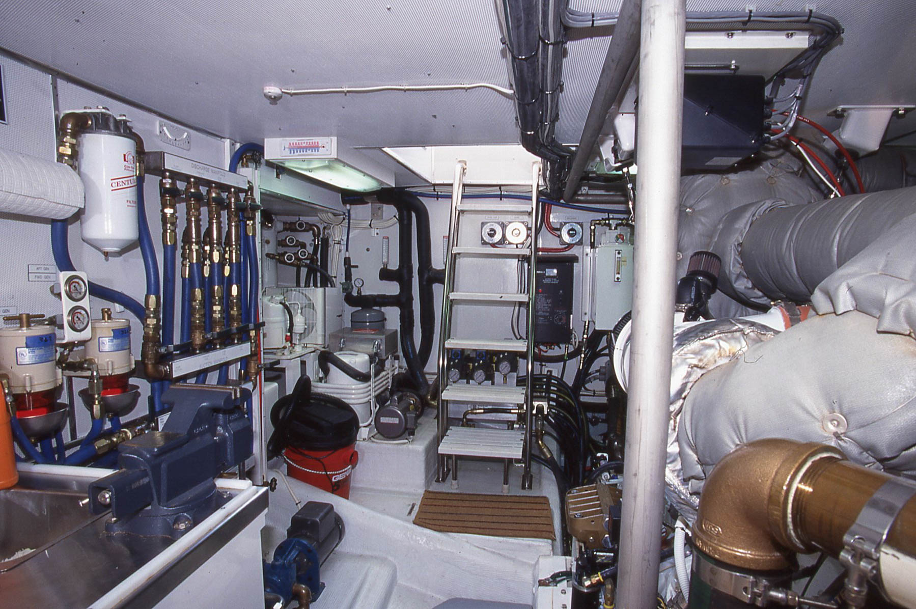 A   very professional engine room done by a builder familiar with the commercial fishing boats that work the waters off Alaska.