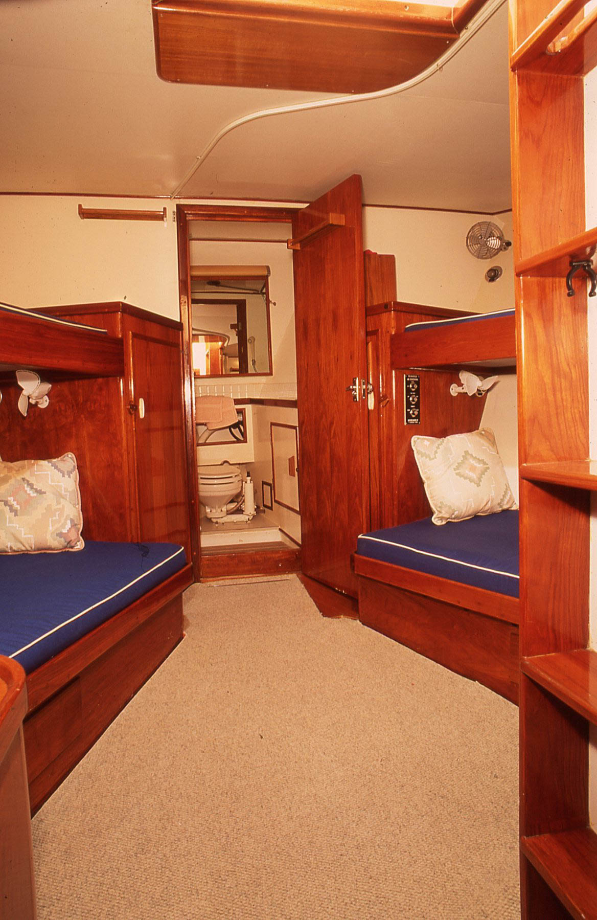This guest stateroom with four roomy berths with plenty of headroom for crew to relax and read books. The guest head is forward.