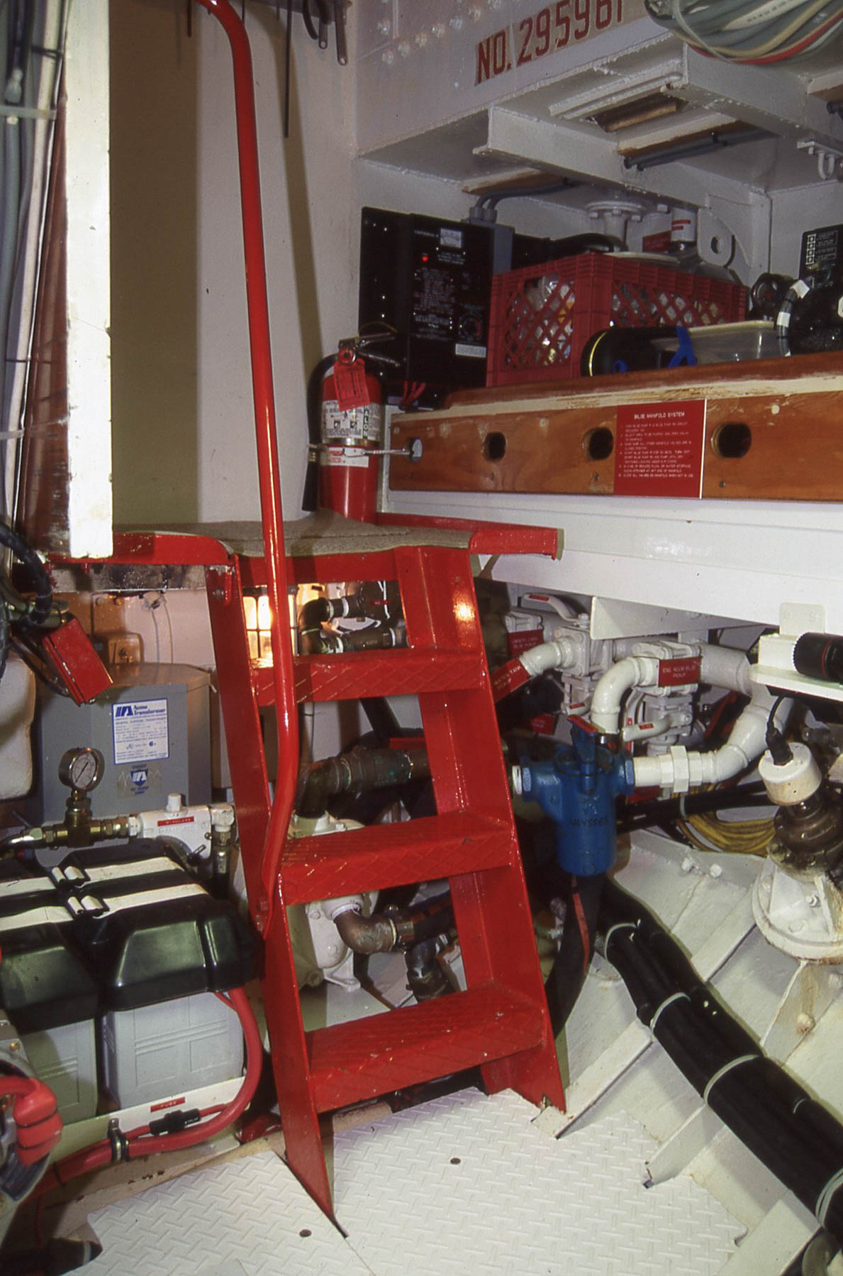A large door opens onto a landing with secure steps and handrail down into the engine room. This is considered important enough to take up space that would otherwise be used for living accommodations. On this passagemaker, the compromise went in favor of the engine room, or as I used to call it, the Holy Place. To stay safe, we need to treat all systems with meticulous care and reverence. It is the heart of the boat.