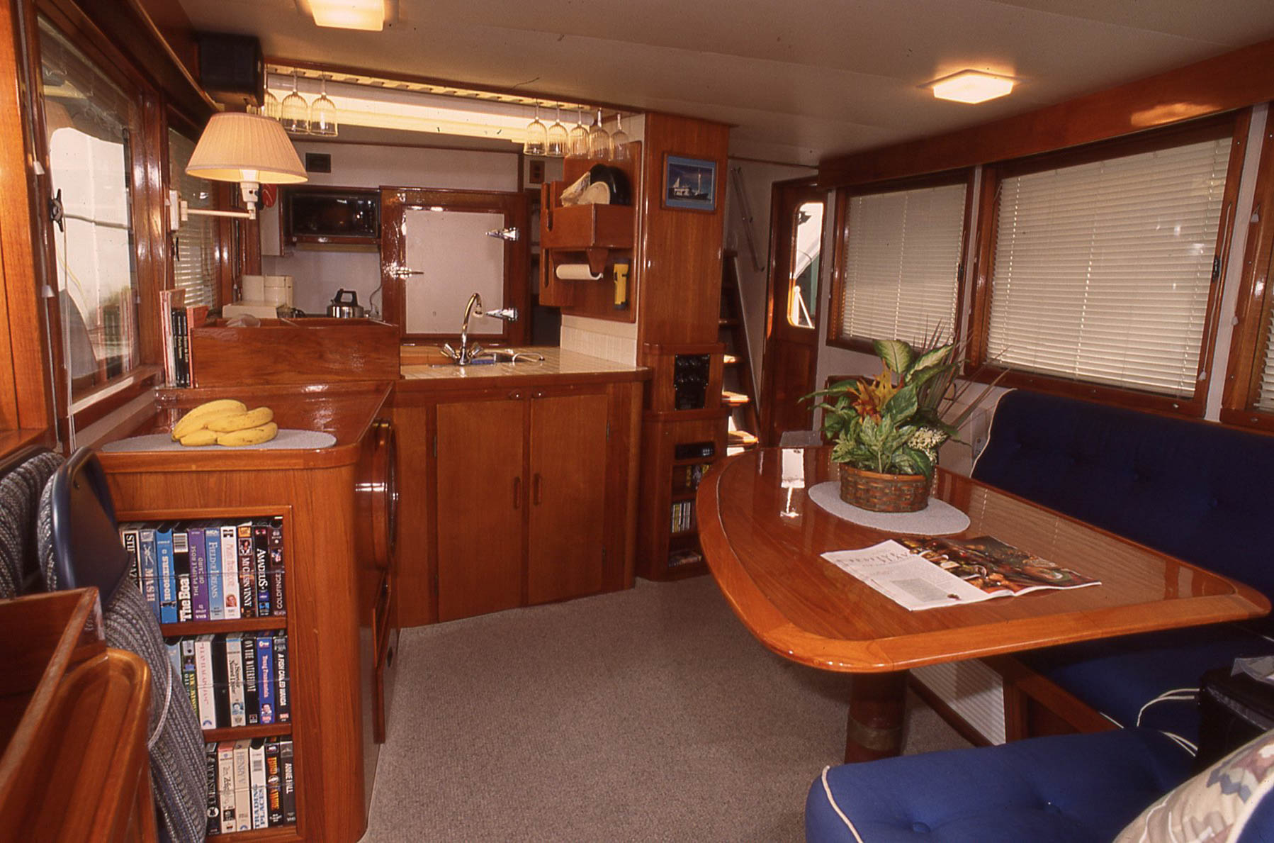 Seagoing saloon and galley. Note the tiny fiddle around the table, and how easy it is to move around this space with numerous places to hold on. This vintage Romsdal was designed to go to sea decades, and modernized by Captains Jerry and Wendy Taylor for cruising today.