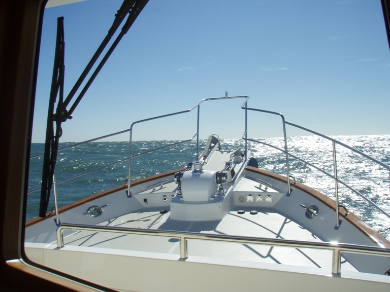 The sparkling bow of the Krogen 58 pointed south. As clean as it gets but not for much longer.