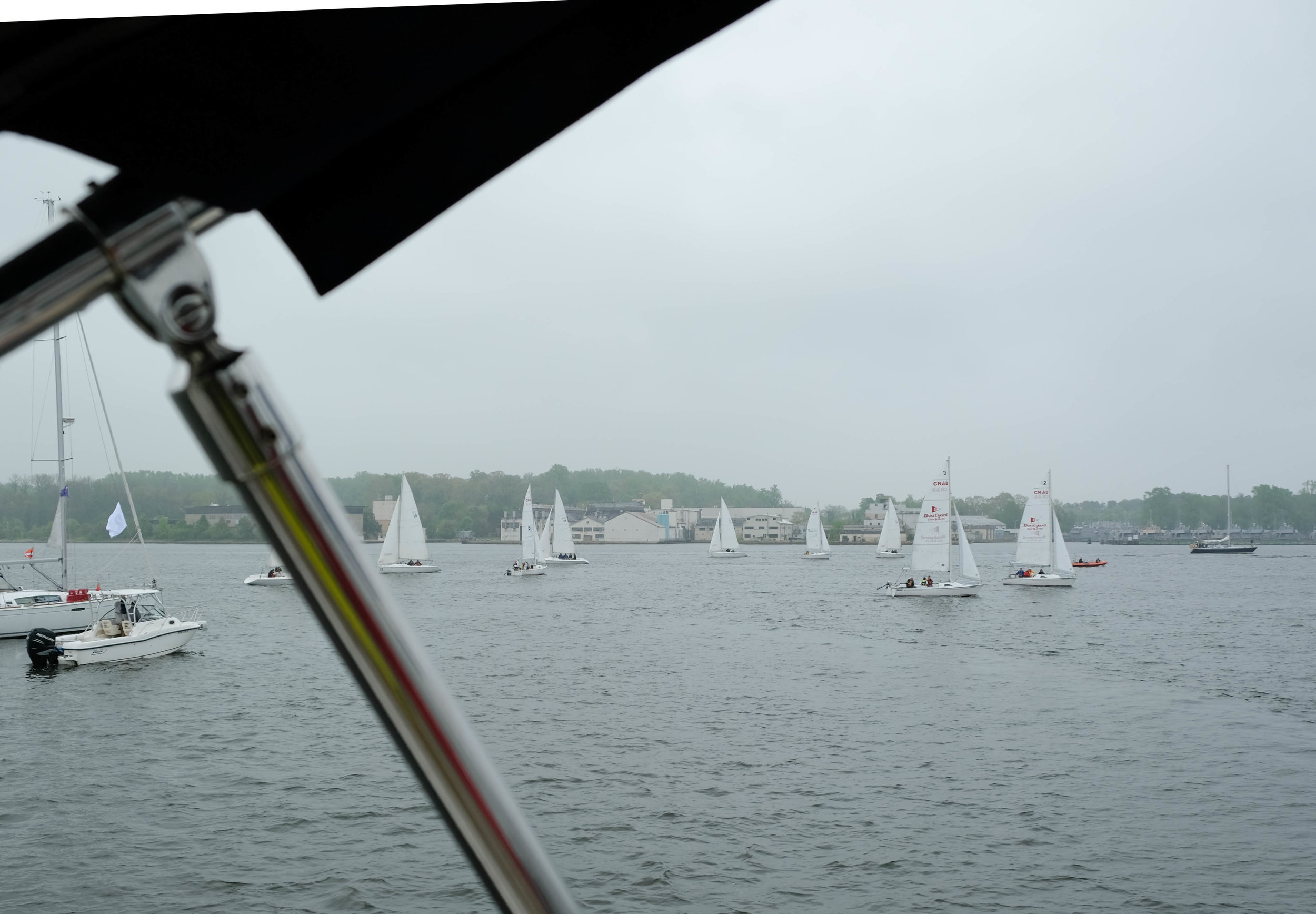 Not a bright sunny day, but the slight drizzle doesn't impact the fun everyone is having, and the midshipmen are honored to be sharing their knowledge of sailing with those who have been on active duty and given more than most in the service to their country.