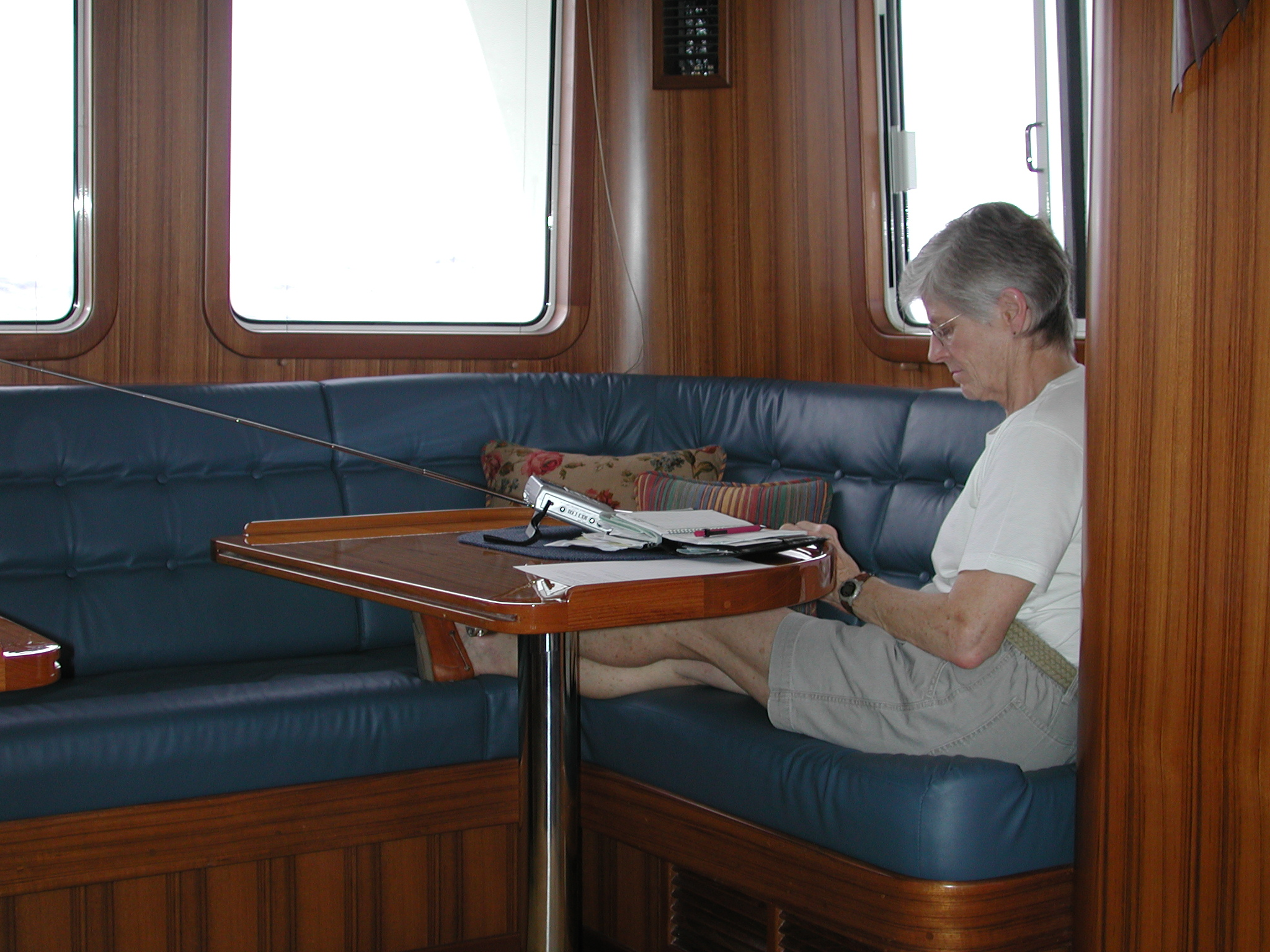 Enjoying quiet time in the pilothouse, away from those on watch, even though the saloon has a couple of wonderful Ekornes Stressless recliner chairs. Unless the saloon door to the cockpit is open, she'd rather be up here.