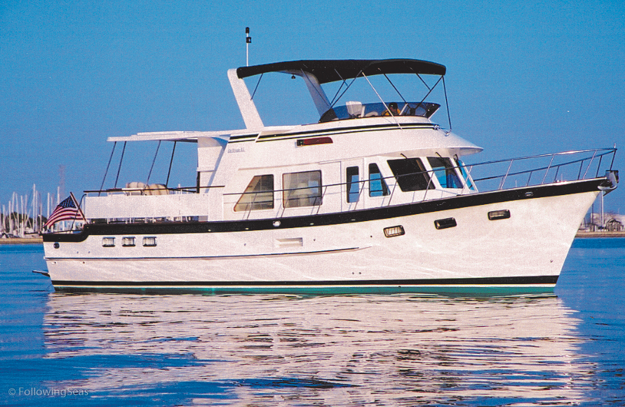 The DeFever 49 is a popular cruising boat and liveaboard. Nice side decks, high stanchions and comfortable flybridge for running the boat.