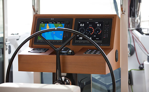 A modern helm for a Torqeedo-powered catamaran seems more Starship Enterprise than a traditional trawler helm. This yacht is a Gunboat.