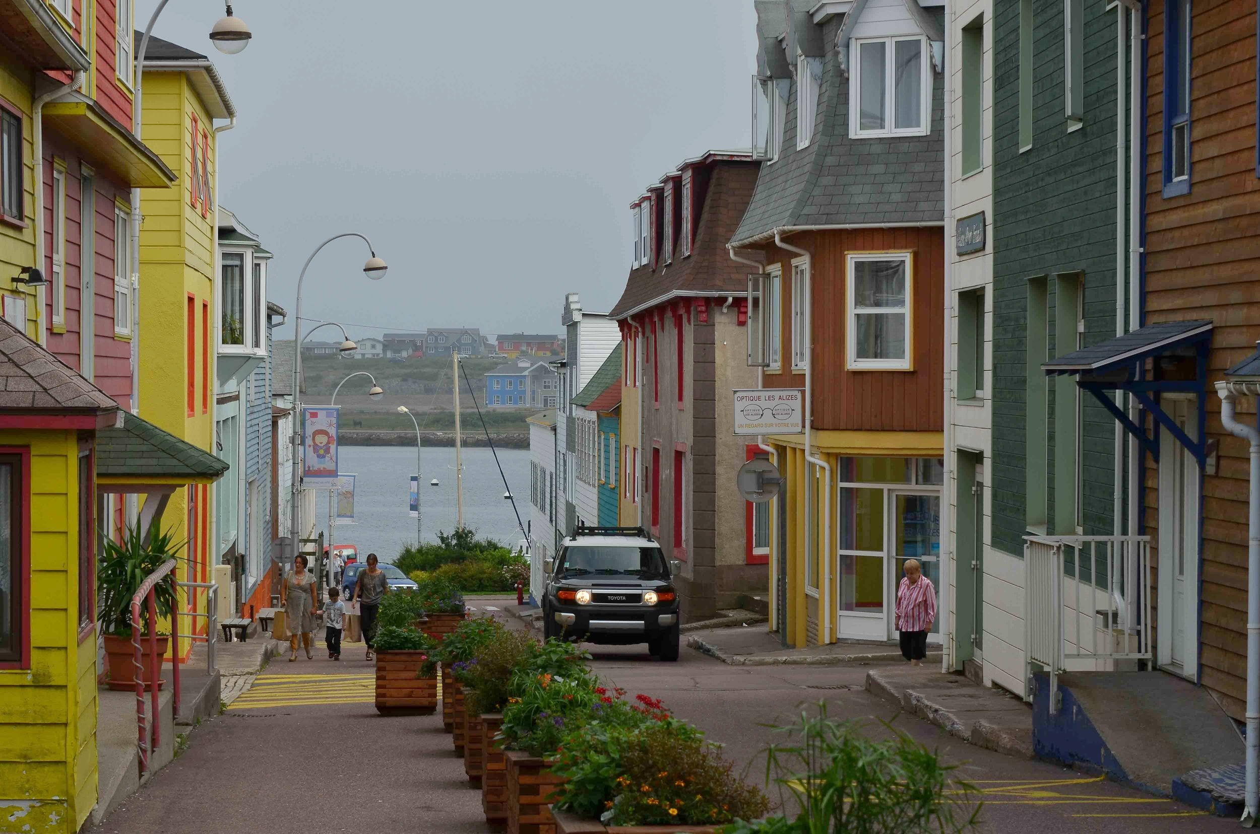 Typical St Pierre street scene. Thirty five miles away in a Newfoundland town we couldn't buy a cup of coffee because there were no cafés or restaurants. In St Pierre you needed reservations for dinner and prices were equivalent to the French mainland.