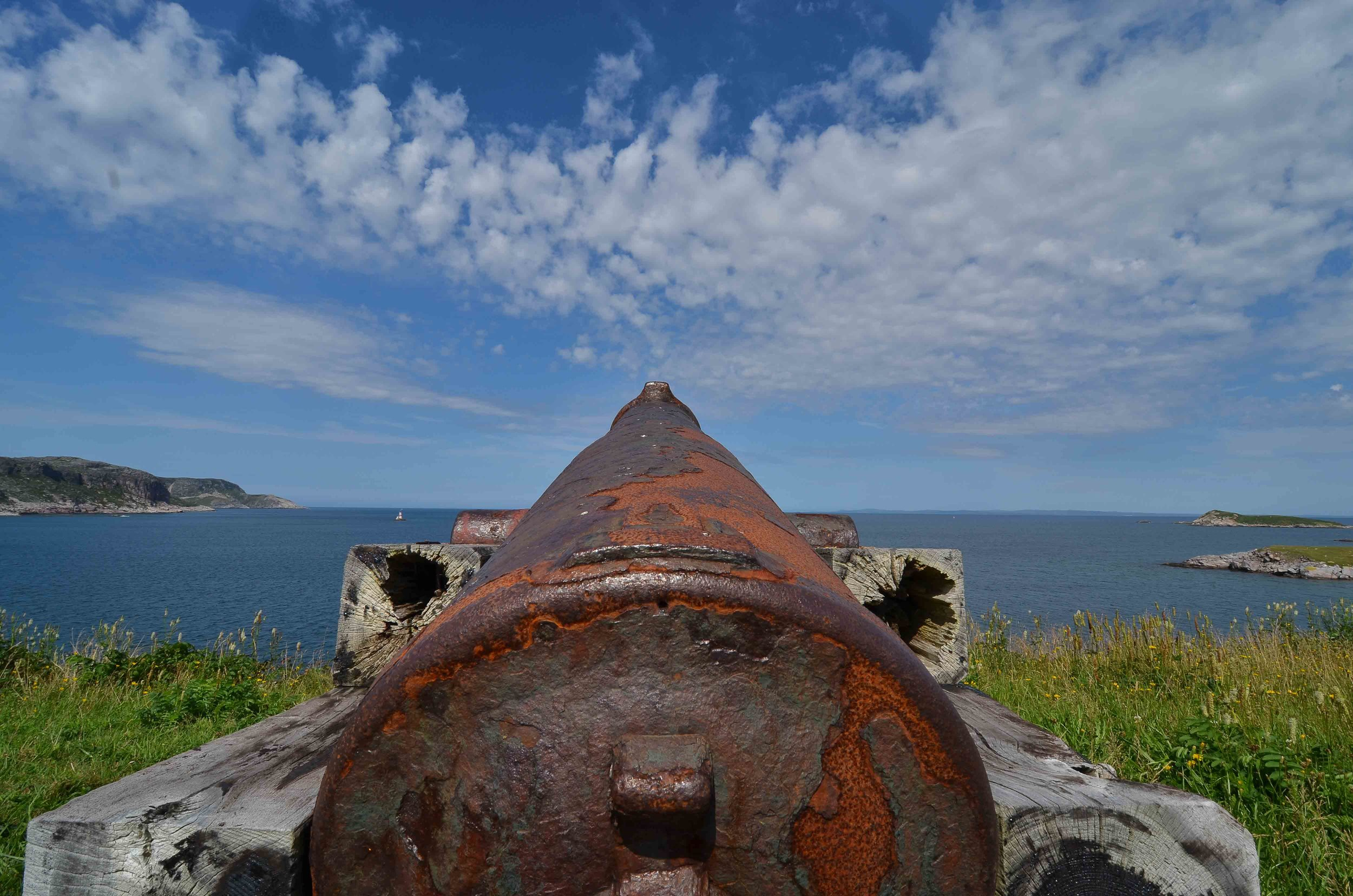 Cannon protecting the harbor entrance to St Pierre. The fort was at the north end of the outlying island of restored fisherman's homes.