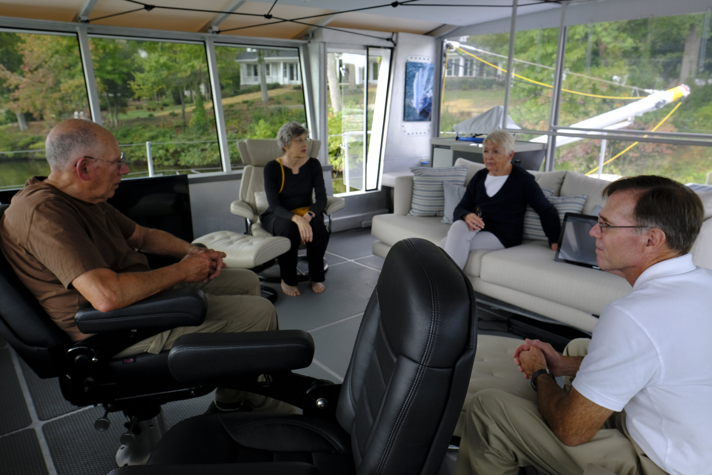 The roomy pilothouse during a visit by neighbors Bob and Janellen Frantz. Bob circumnavigated a few years ago with his son aboard their Hallberg-Rassy sailboat. They were impressed by the many innovative details on the 78-foot FPB.