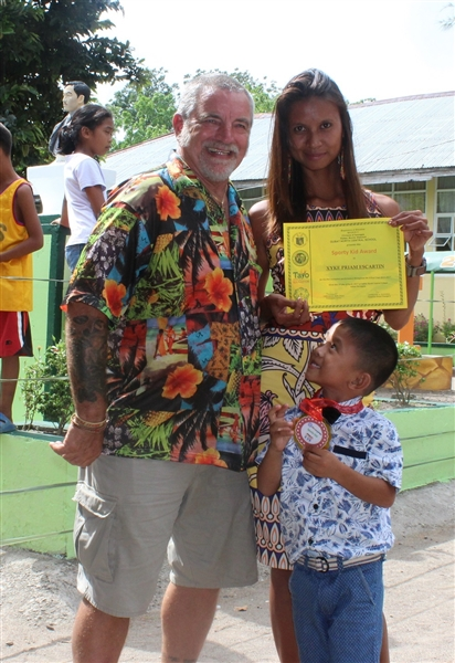 Brian and Donna celebrate the kindergarden graduation of her son, Piam.