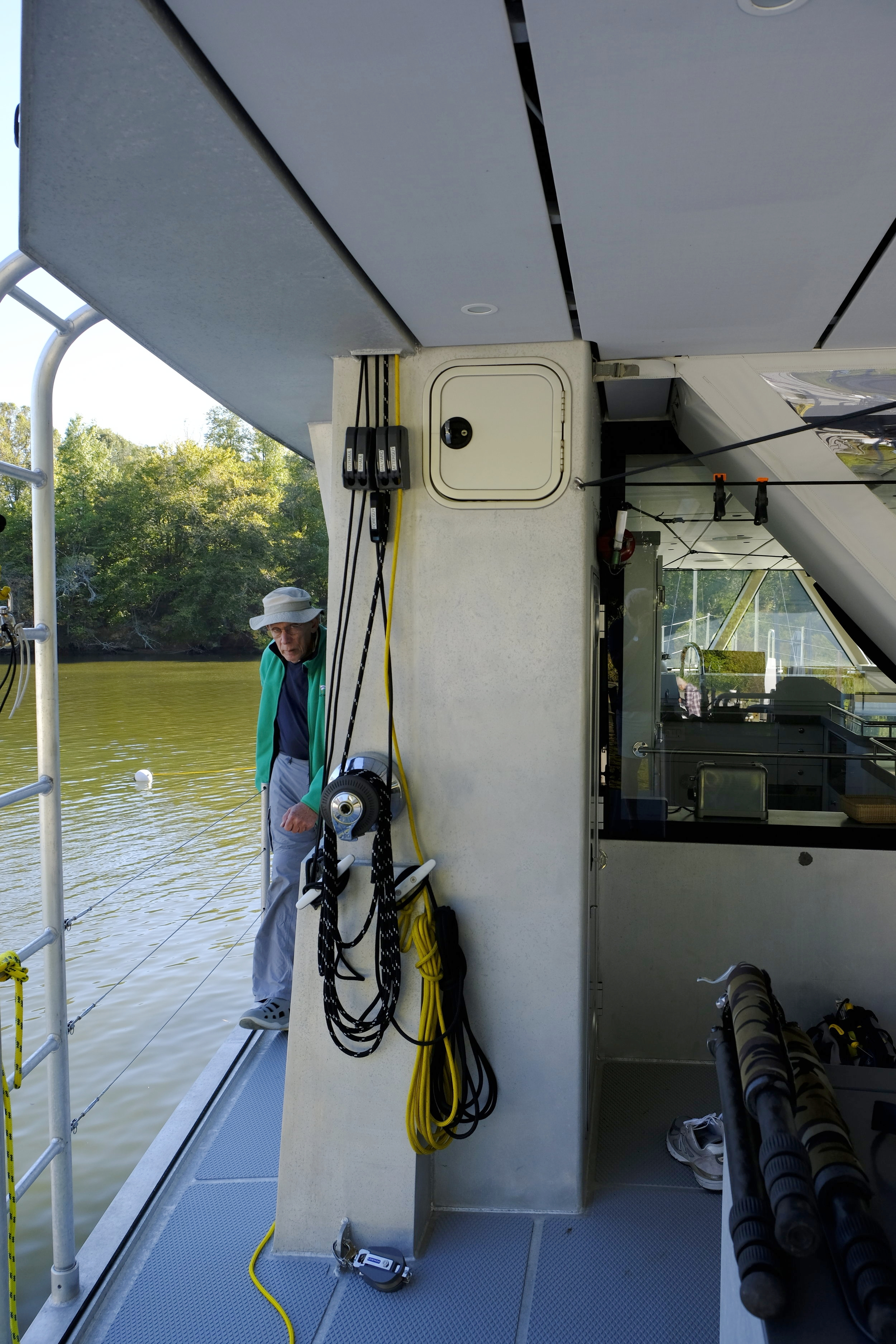 Winches and jam cleats on both sides of the boat control the boom and adjust the cars on the track that move the strut ands boom sideways, as well as lifting the RIB and rowing boats.