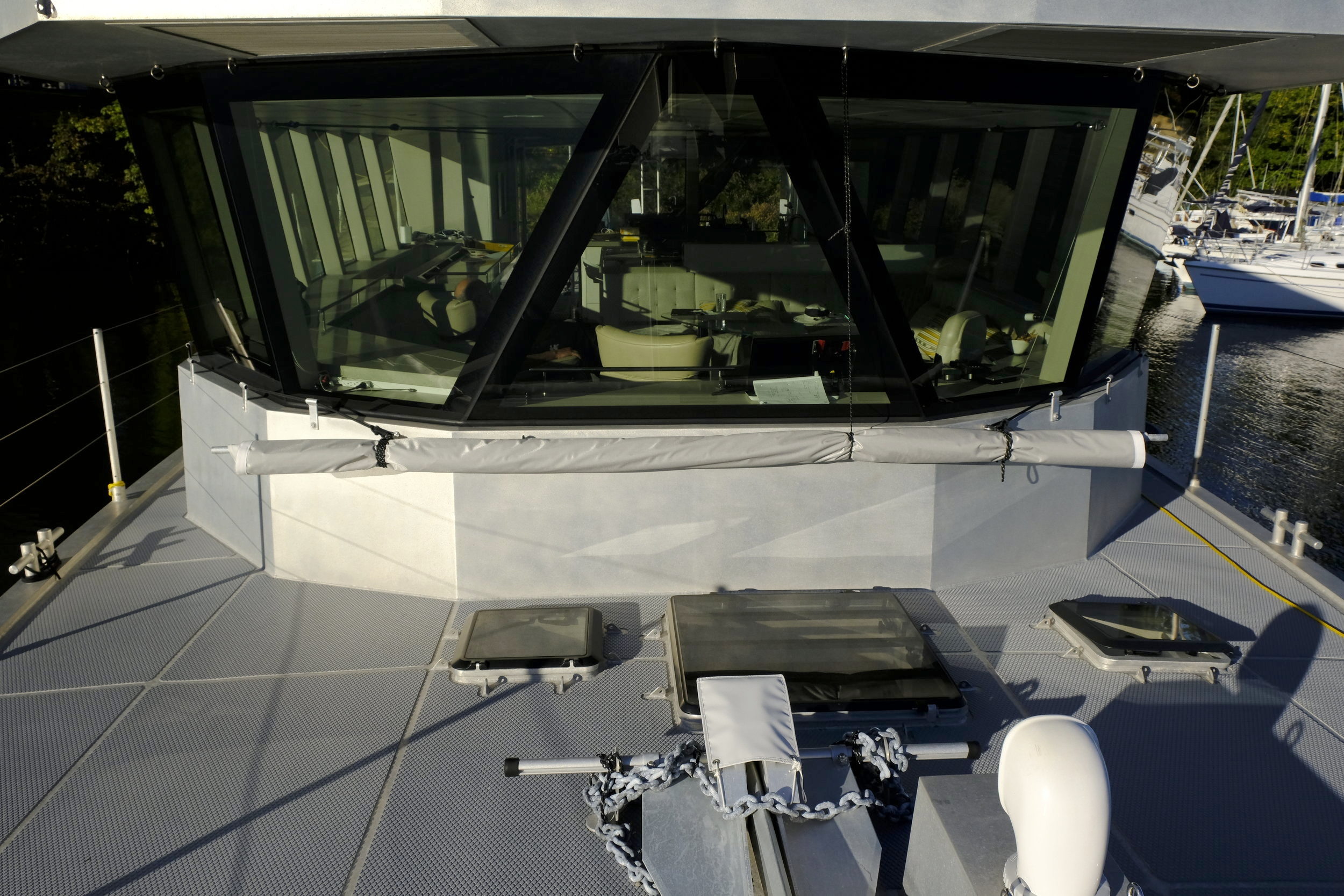 This awning covers the forward accommodations and is very effective at anchor with the hatches open in the tropics. I don't know why more boats take advantage of such simple ways to keep temperatures down in paradise.