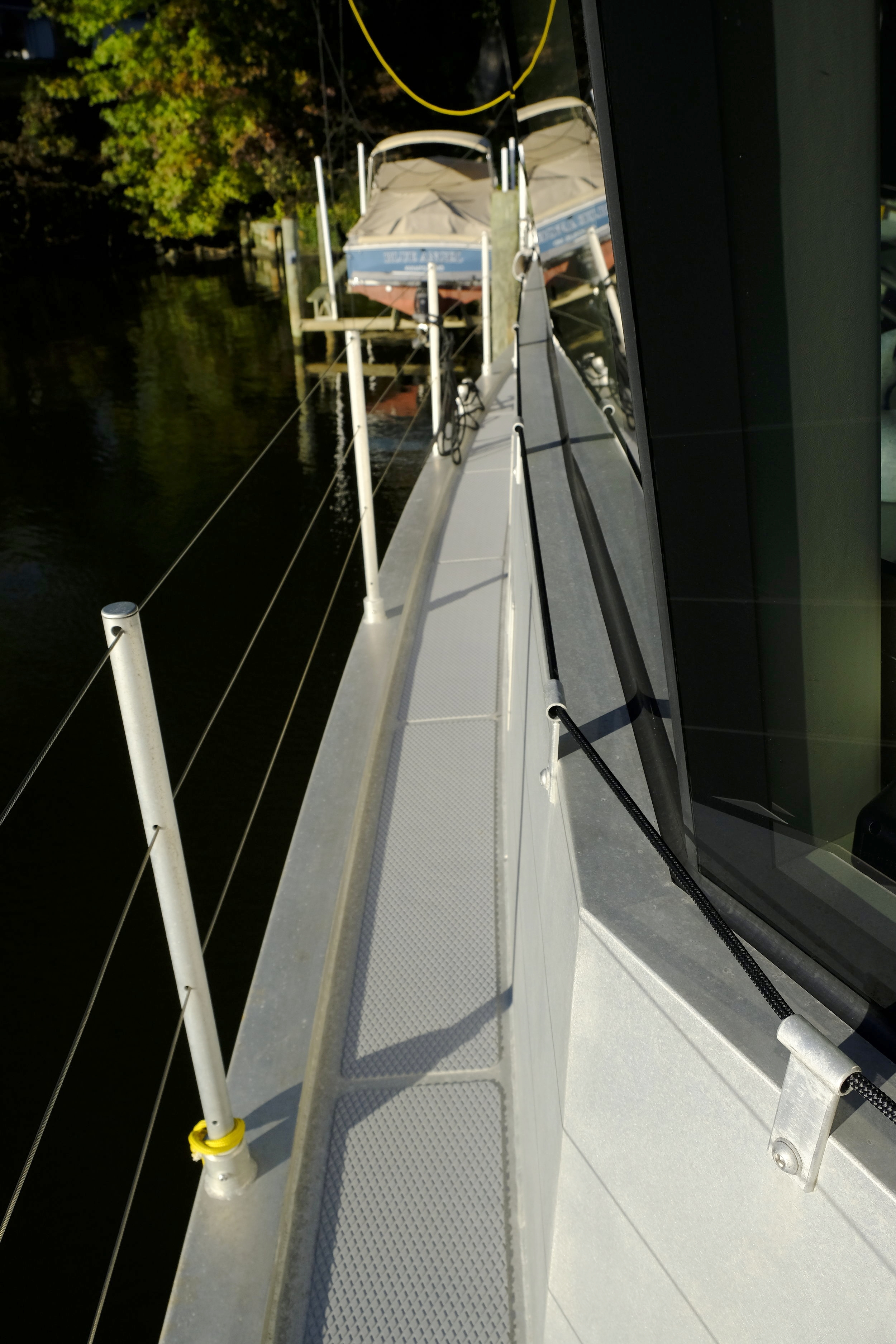 Spectra line makes a great hand hold while moving along side decks. The line runs through brackets that attach using the threaded holes created for the boat's storm shutters.