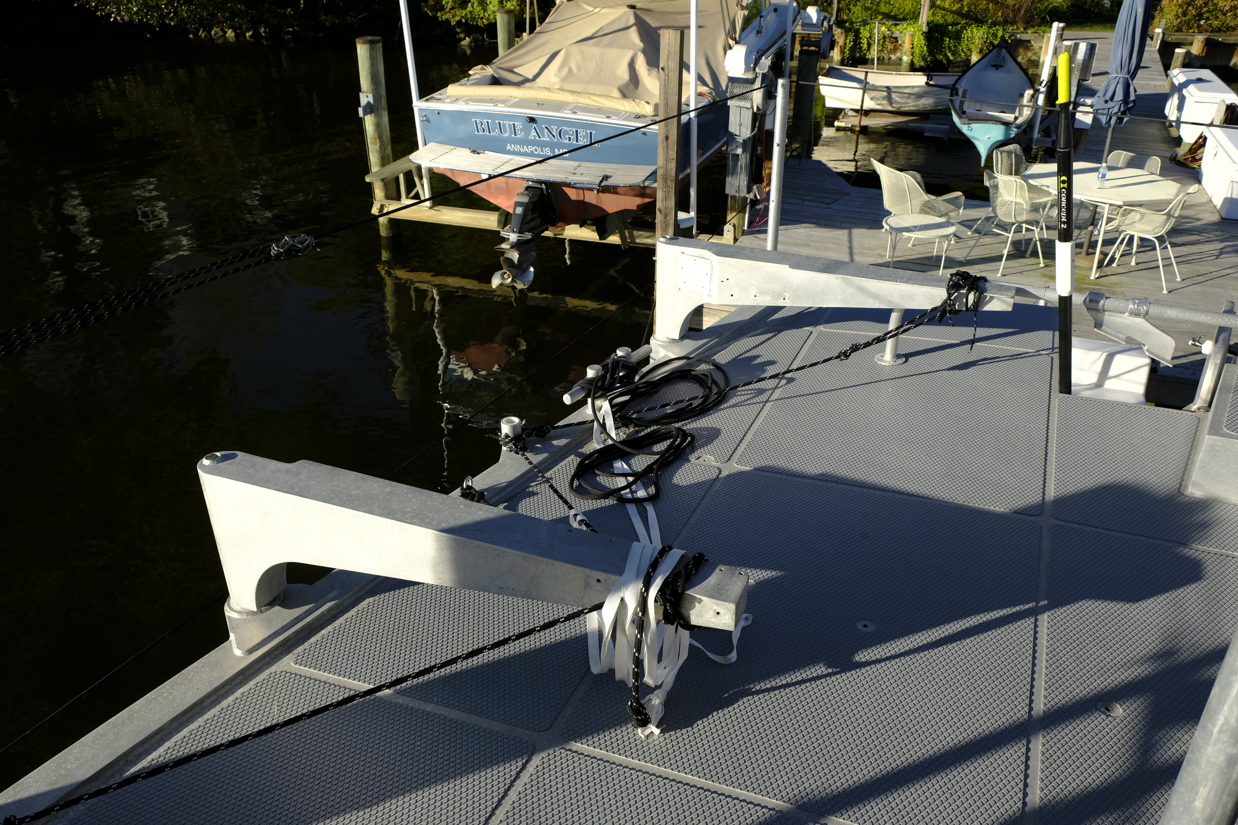 The cradle arms for the RIB swing out to hold the dinghy off the side of the boat, creating a large social area on the aft deck.