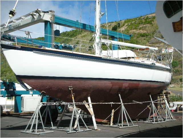 KANDARIK hauled out for 9 months in Praia Da Vittoria, Terceira, Azores. Note the Spanish Windlass of lines around the jack stands in case of earthquakes. Yes, we cleaned the bottom and repainted with anti fouling before we launched the next spring.