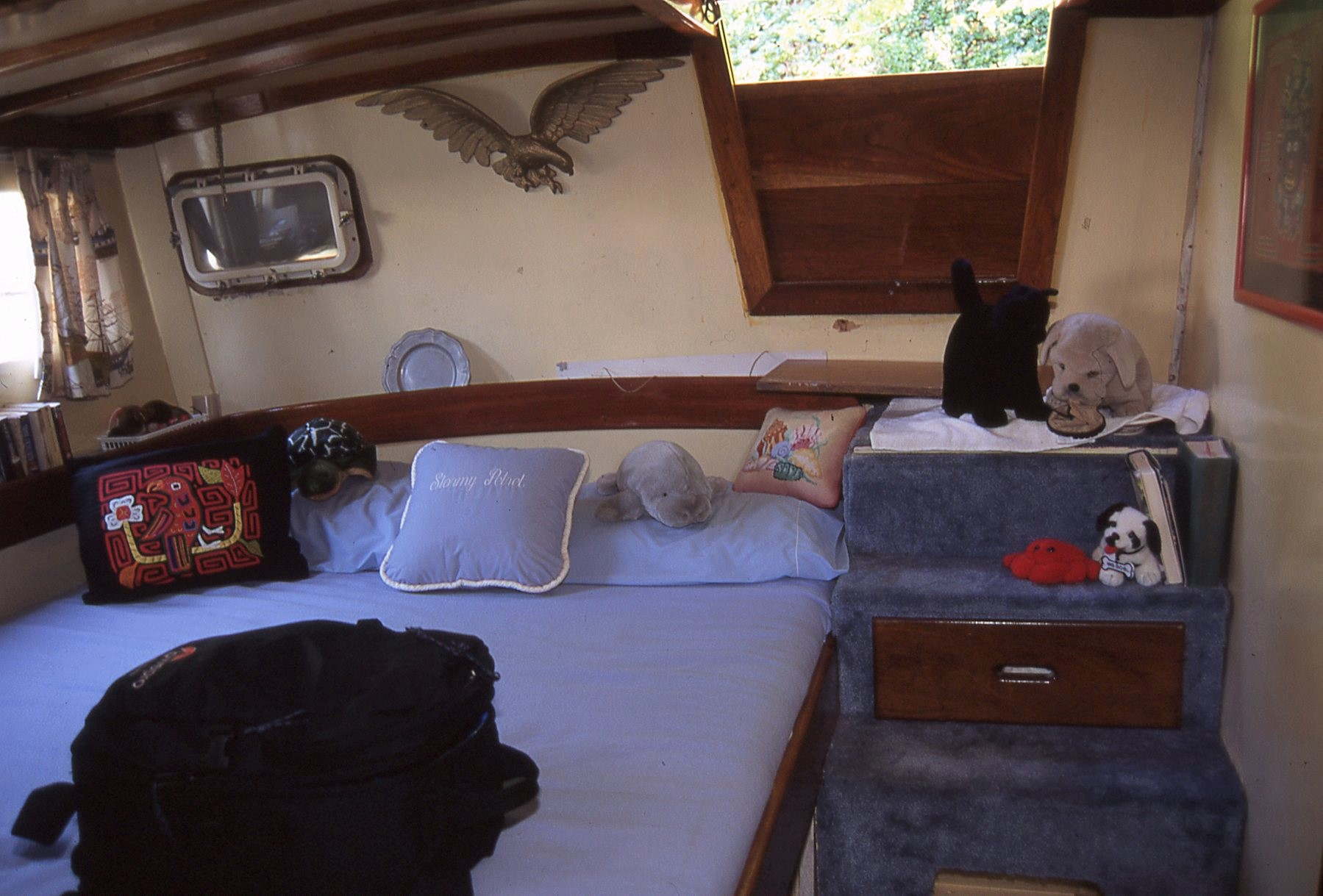 The carpenters in Cartagena did work on the boat when they stayed in Columbia, expanding the aft cabin. Not the red Mola pillow from the San Blas Islands.