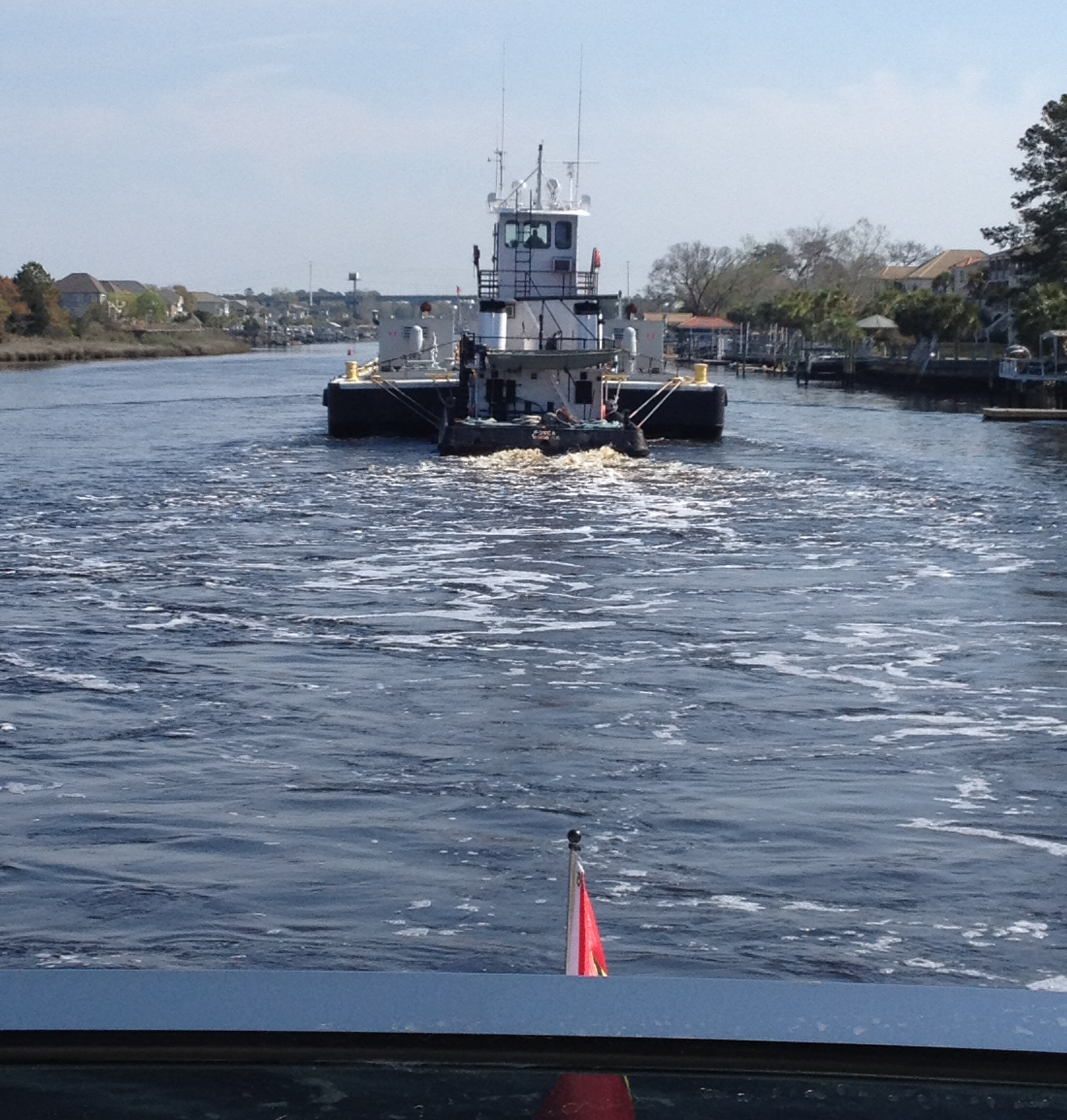 Following a tug and barge.jpg
