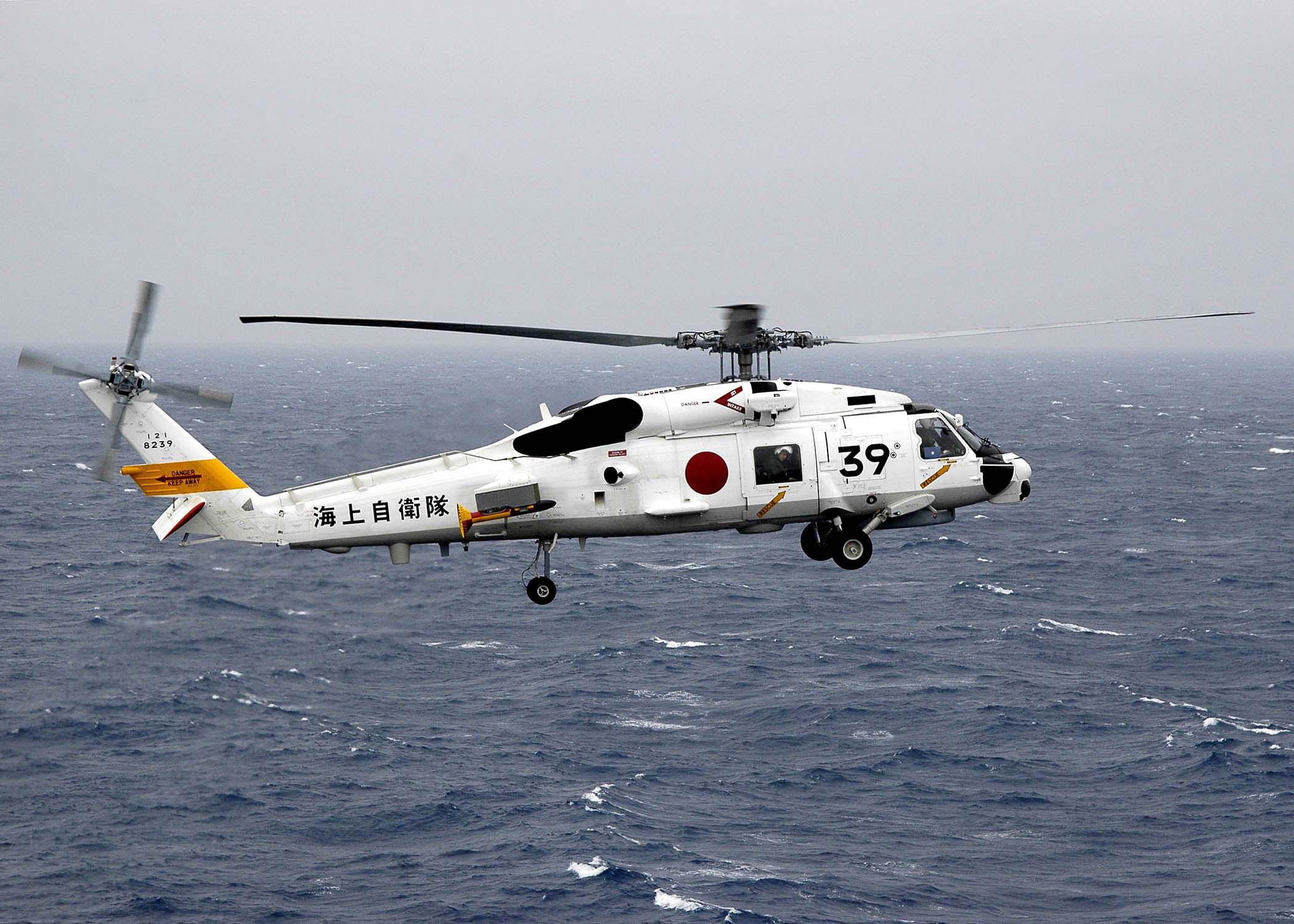 US_Navy_060322-N-7981E-015_A_Japan_Maritime_Self_Defense_Force_SH-60J_helicopter_carrying_Commander_Destroyer_Squadron_Nine_(CDS-9),_Capt.jpg