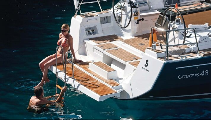 A good compromise between convenience and security found on this Beneteau Oceanis 48. Notice the hinged swim platform that can be pulled up flush to the transom, leaving no steps available from a small boat.