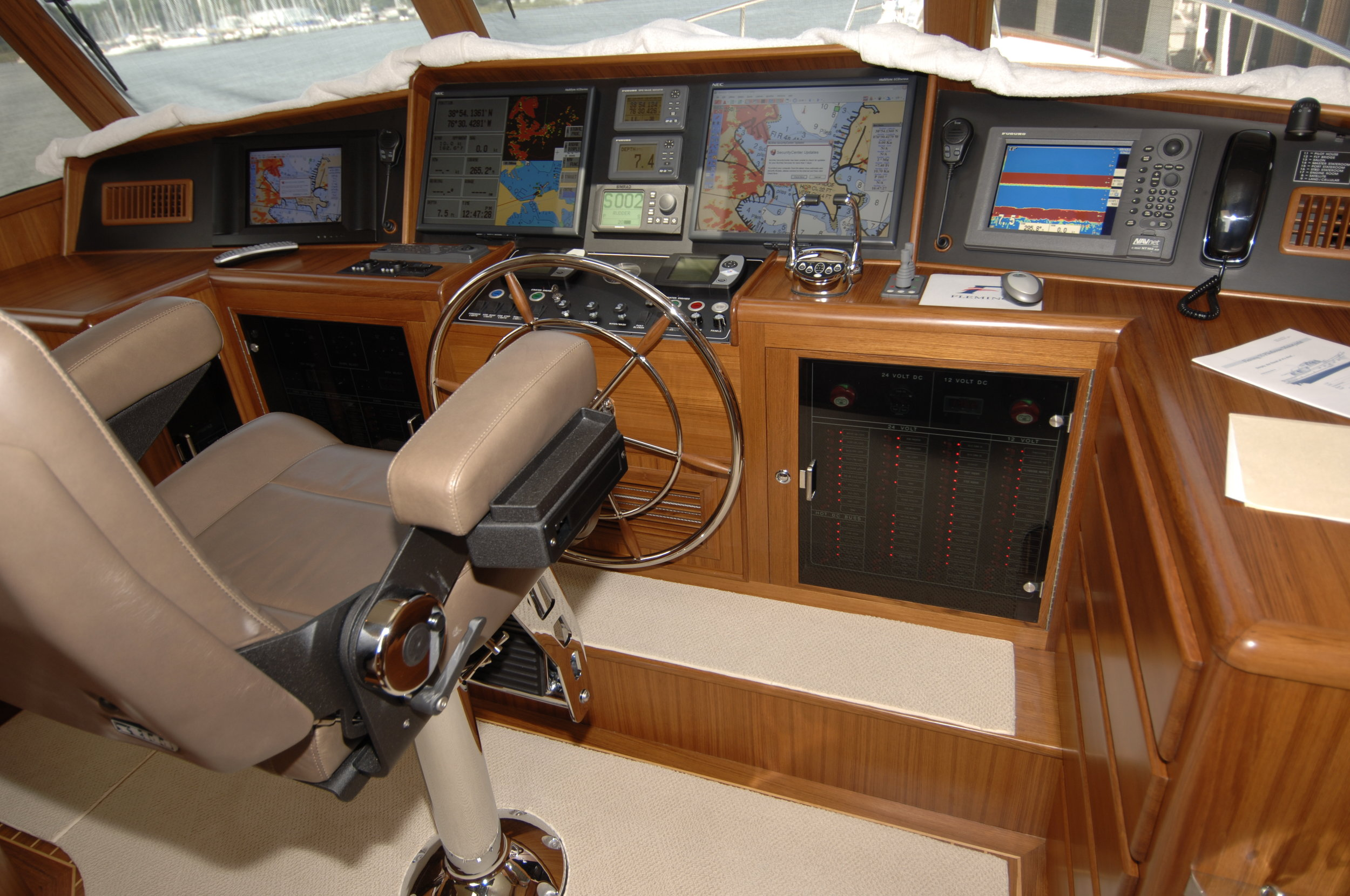 This beautiful Fleming 55 pilothouse has plenty of storage and drawers to designate where common items are to be stored. The captain must insist all crew follow this routine, so the helm is not a cluttered mess by the end of the cruise.