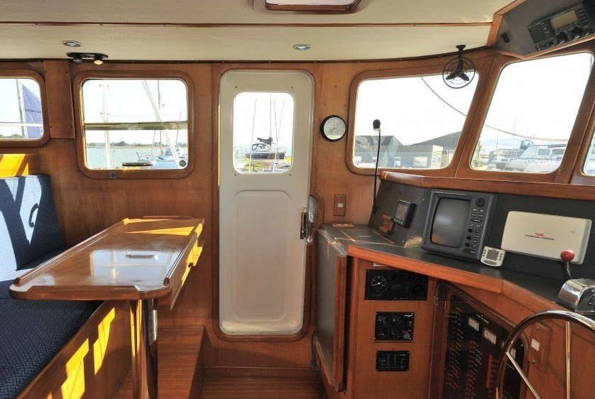 Electronics spread across a wide console means you can't drive the boat from a helm chair and effectively use the Furuno radar or plotter at the same time. Note the genset panel located under the console.