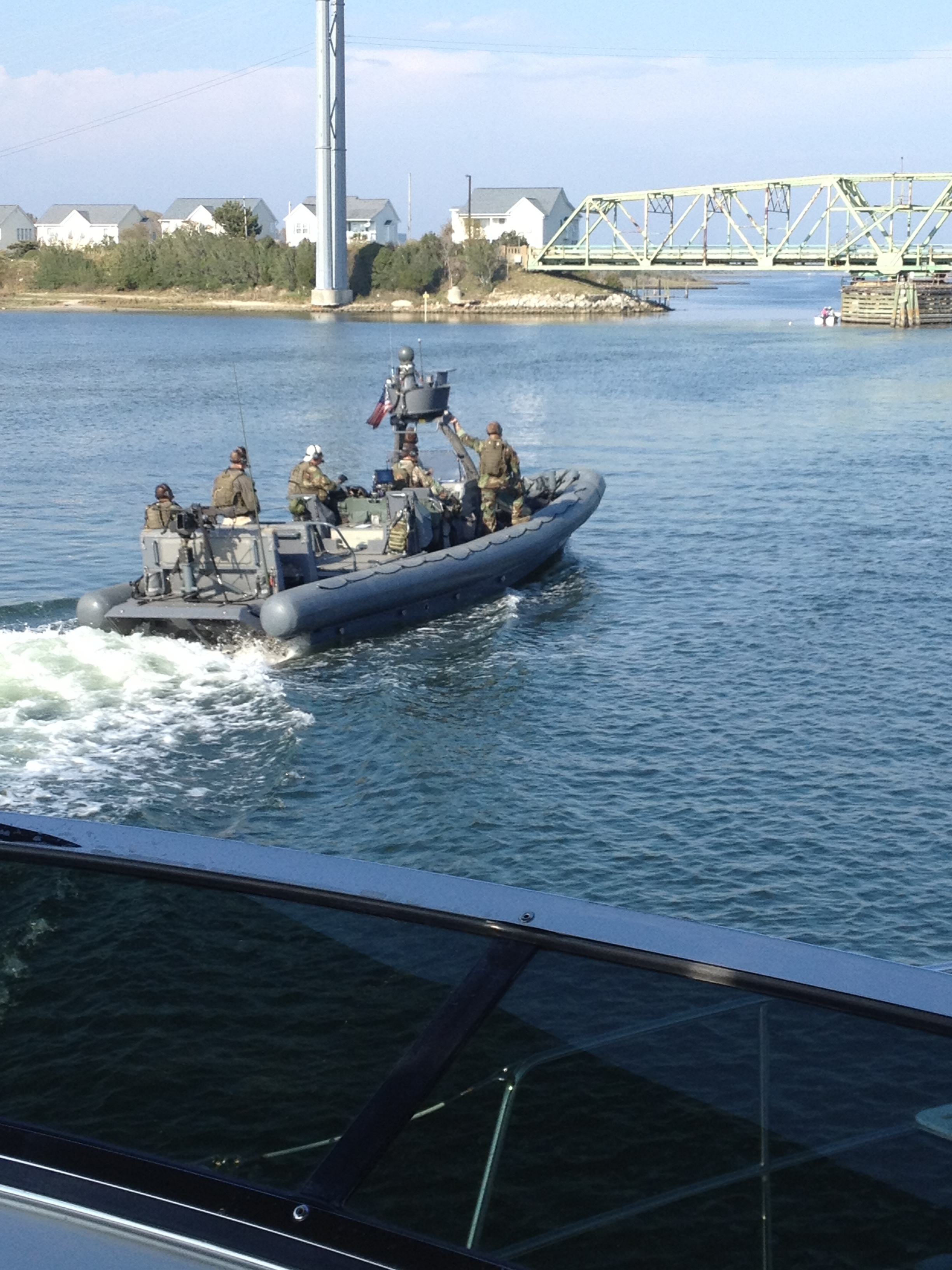 In most cases, a bigger boat has some degree of authority over a small boat…except when it is full of armed Marines.