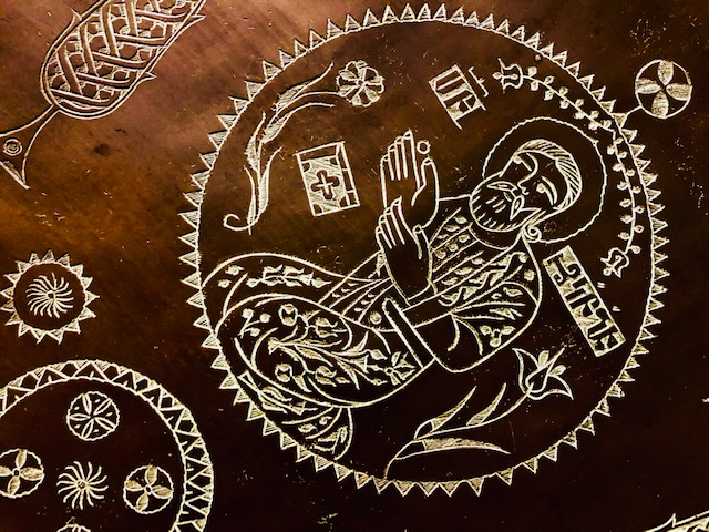 A 16th century copper tray depicting Christ & the 12 Apostles in illuminated manuscript style