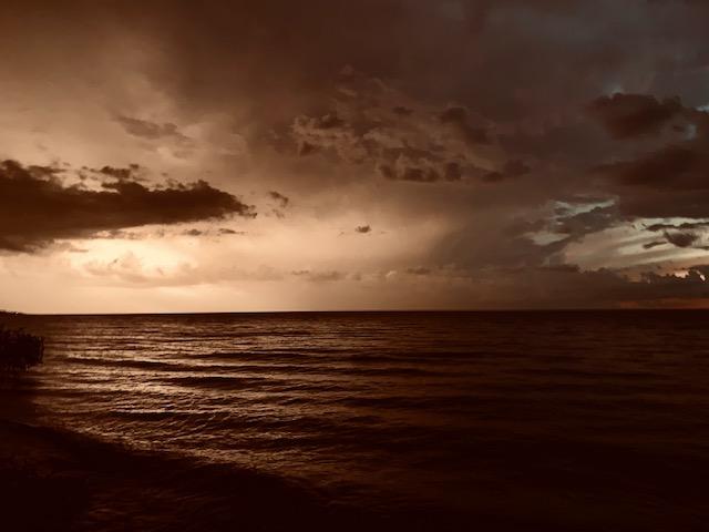 Big, booming, late summer lightning and thunder storms (Osicecas) illuminate Lake Michigan's eastern shoreline.