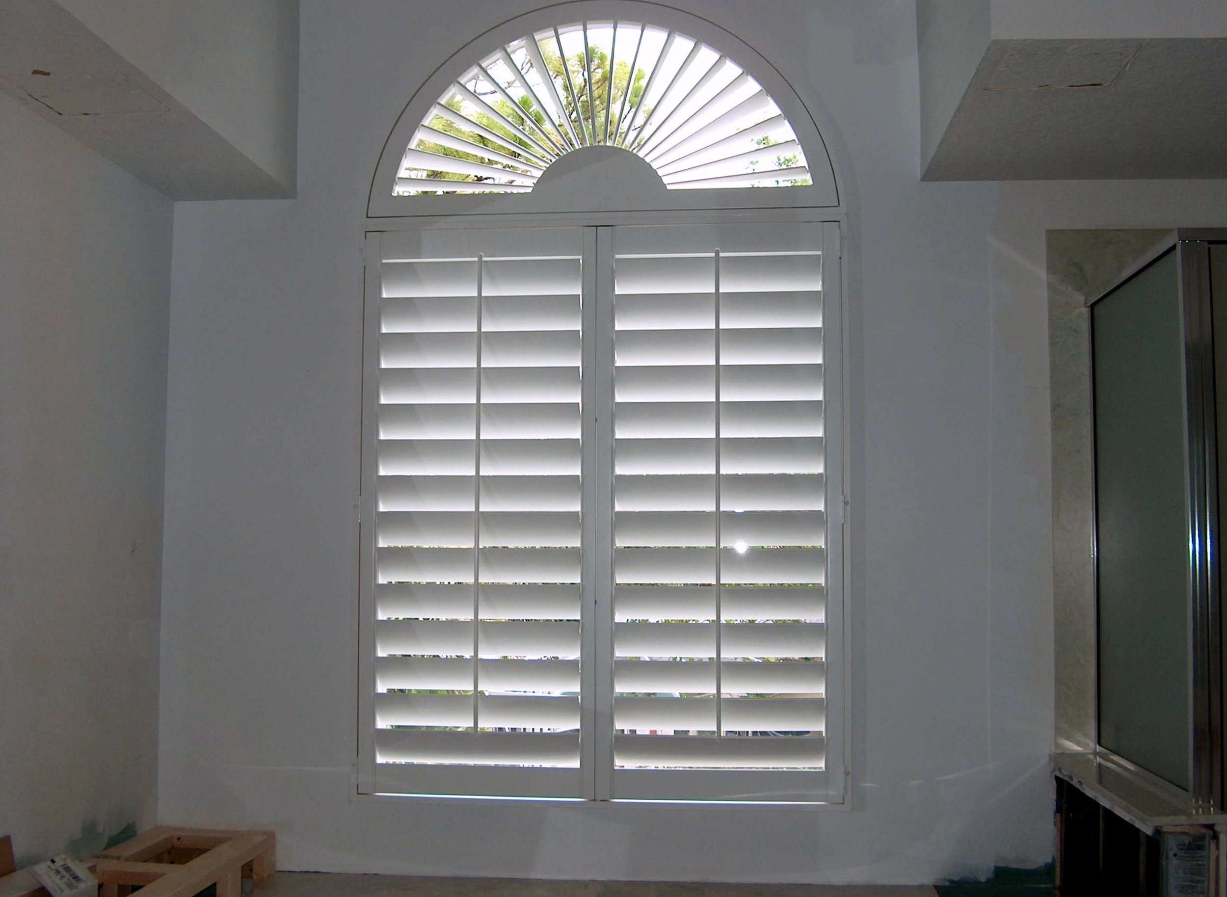 White Wood Shutters with Sunburst on Top